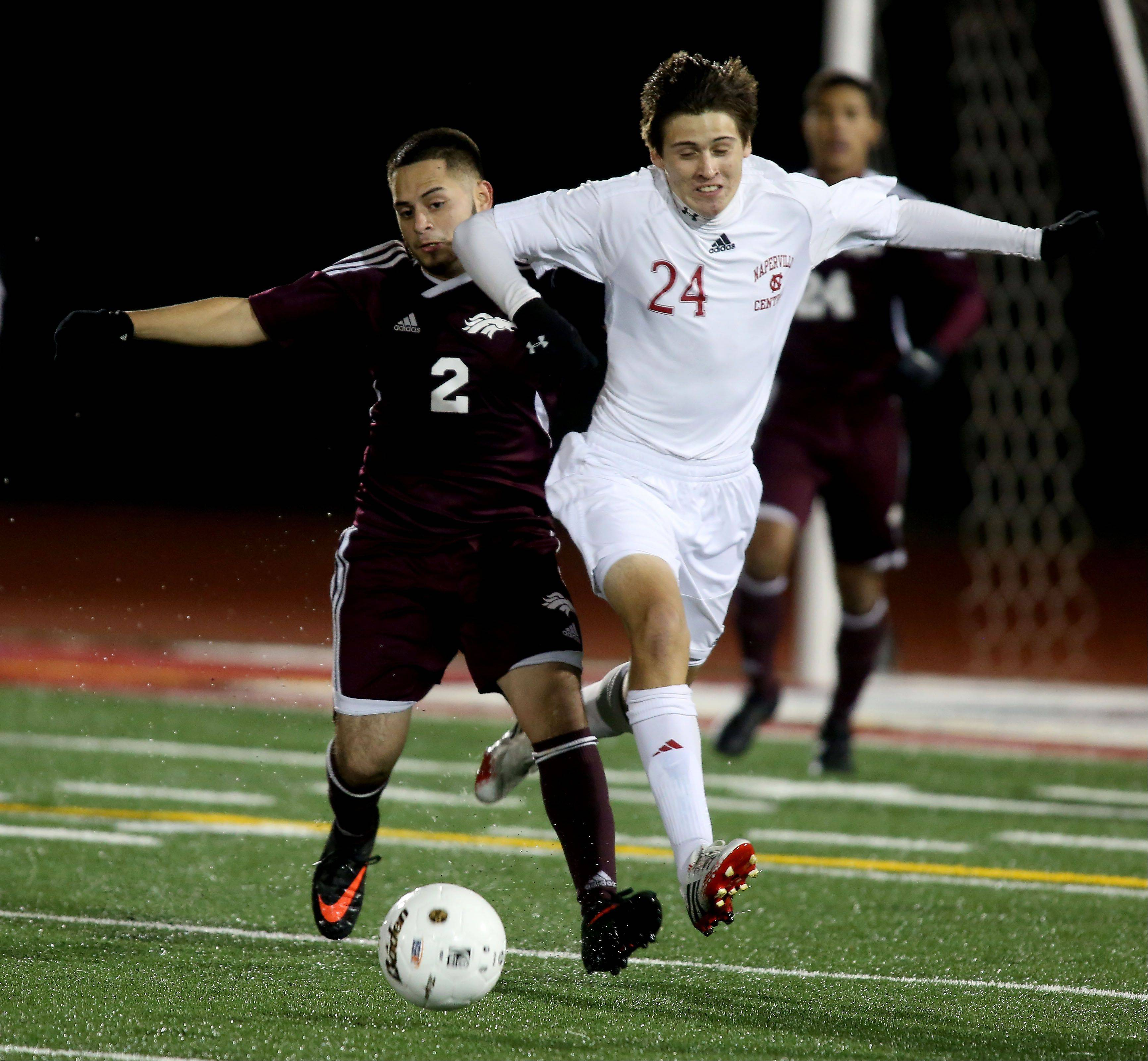 Nick Coon of Naperville Central, right, chases down a ball with Chabelo Marquez of Morton during Class 3A super-sectional soccer in Romeoville on Tuesday.