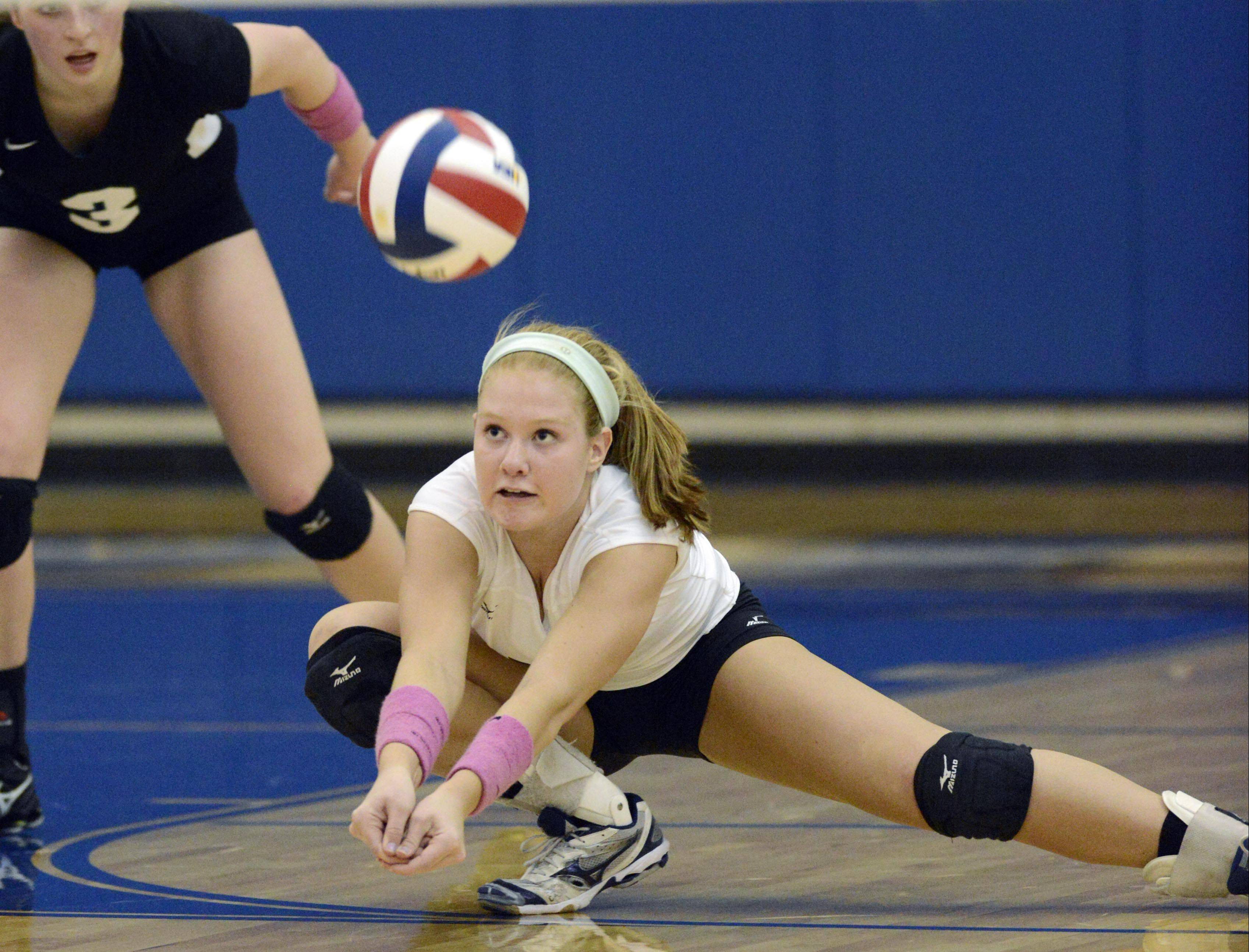 Glenbard West's Meg DeMaar digs a back row Geneva shot Tuesday in Geneva.