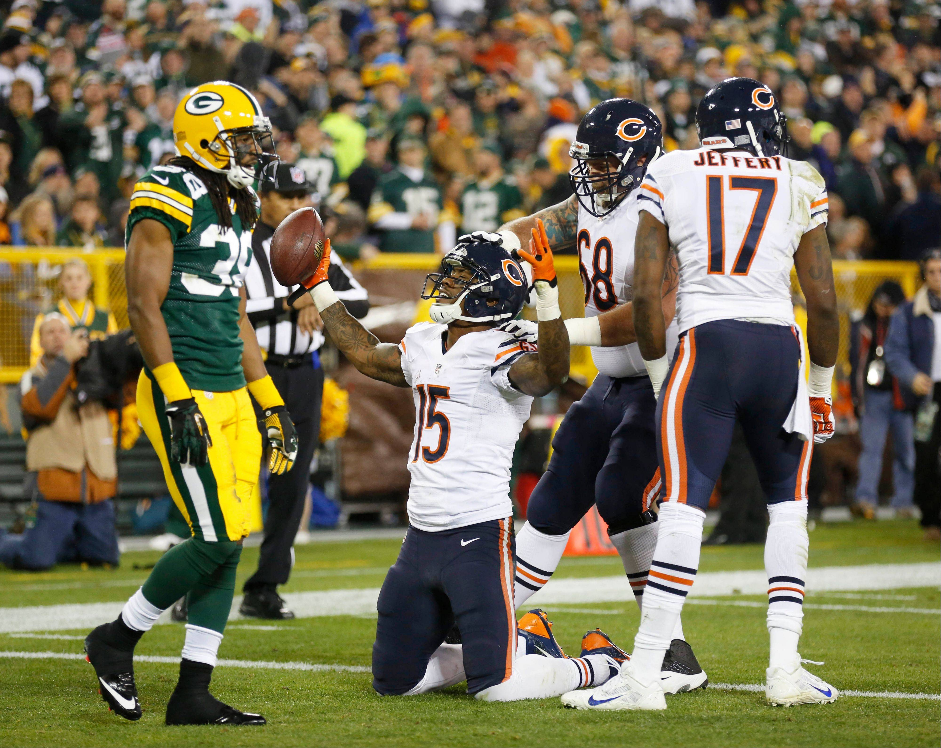 Chicago Bears' Brandon Marshall celebrates after a touchdown reception during the first half.