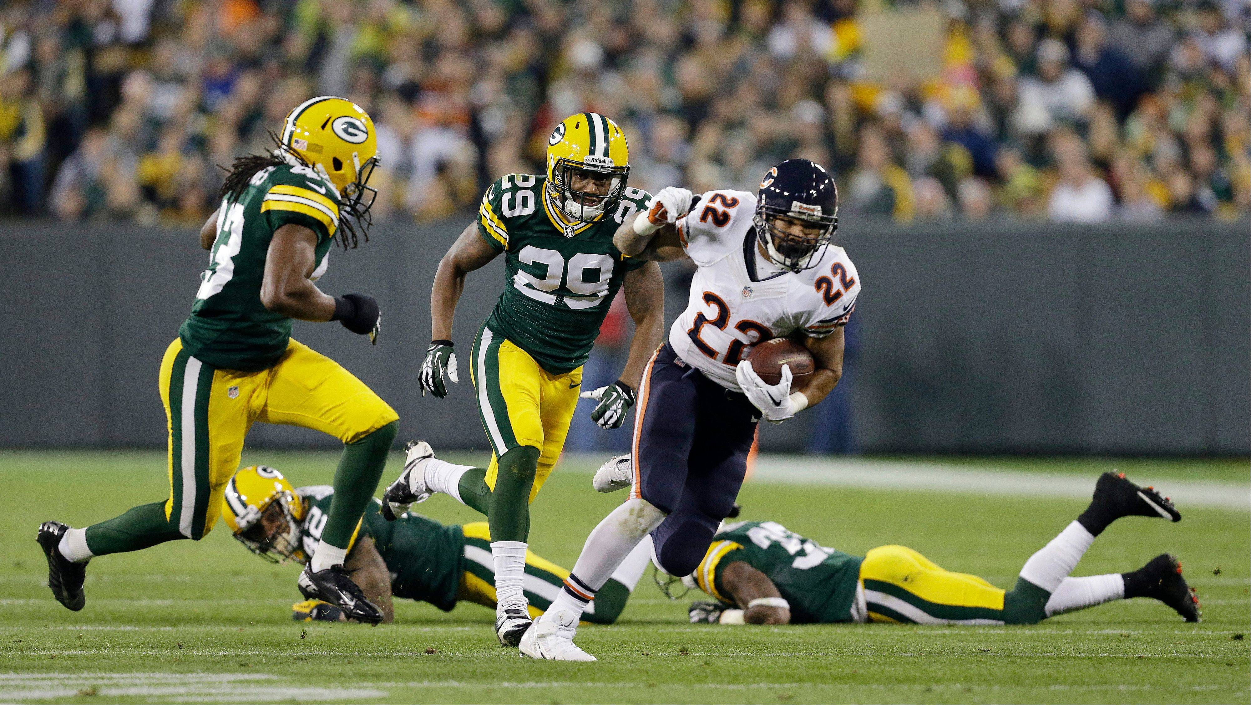 Green Bay Packers' Jerron McMillian (22) breaks away during the first half.