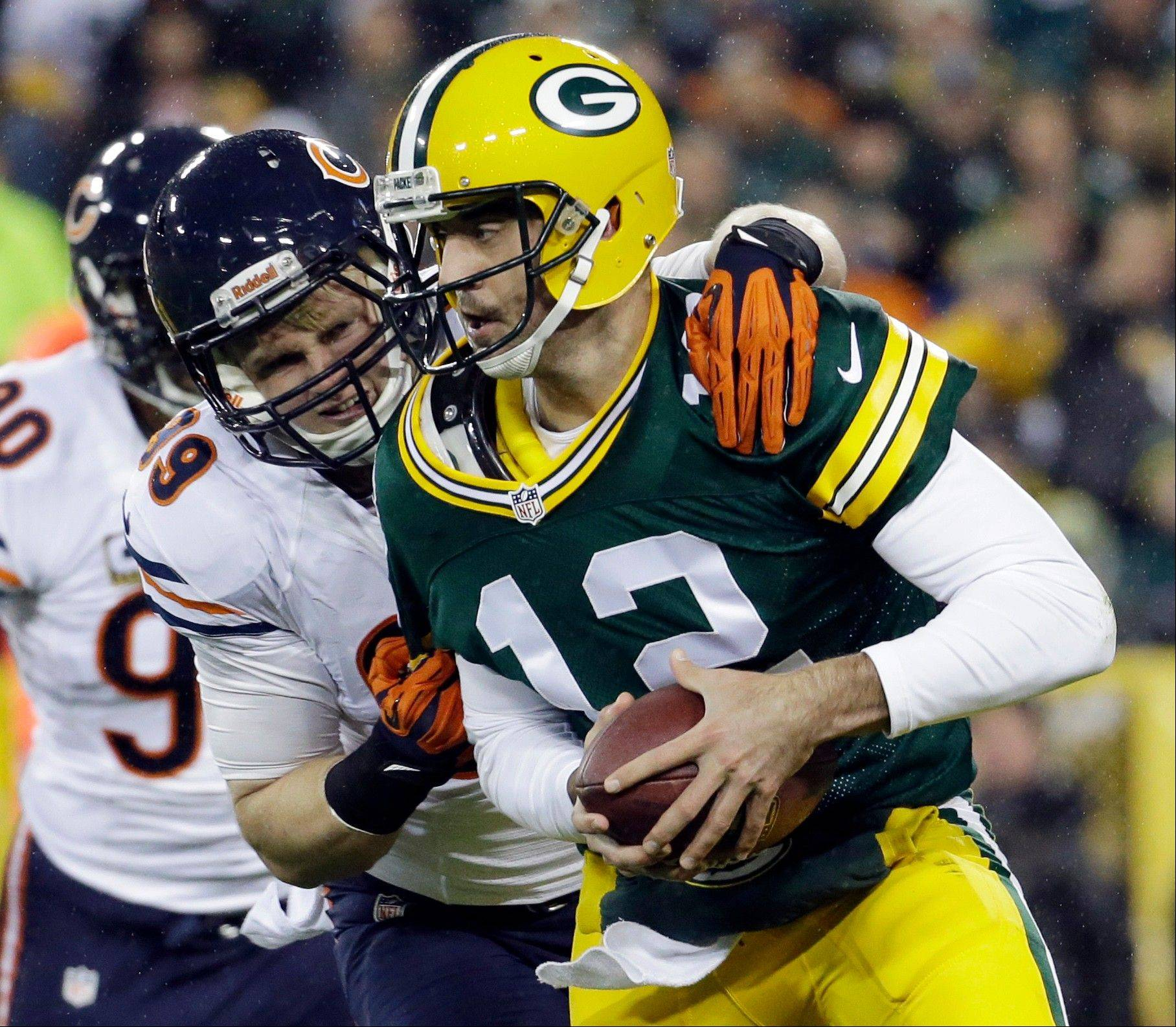 Green Bay Packers quarterback Aaron Rodgers is sacked by Chicago Bears' Shea McClellin during the first half .