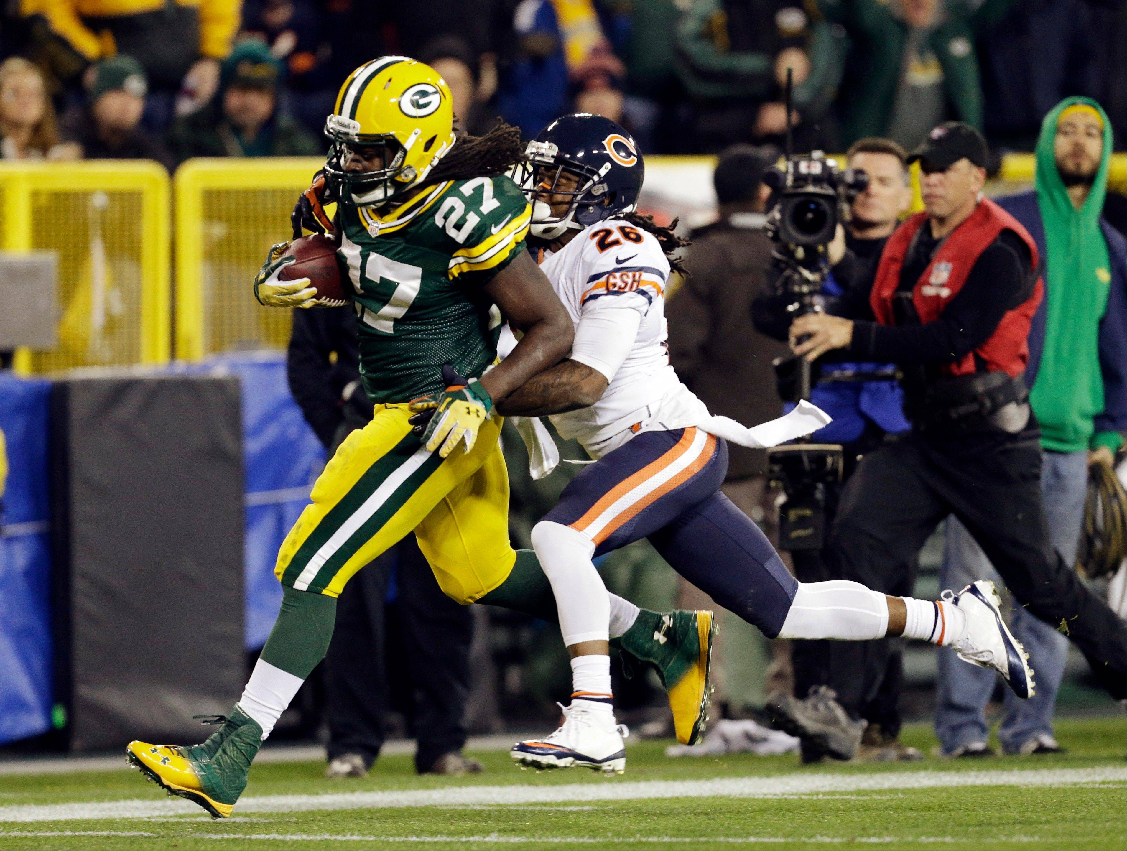 Green Bay Packers' Eddie Lacy breaks away from Chicago Bears' Tim Jennings for a 56-yard run during the second half .