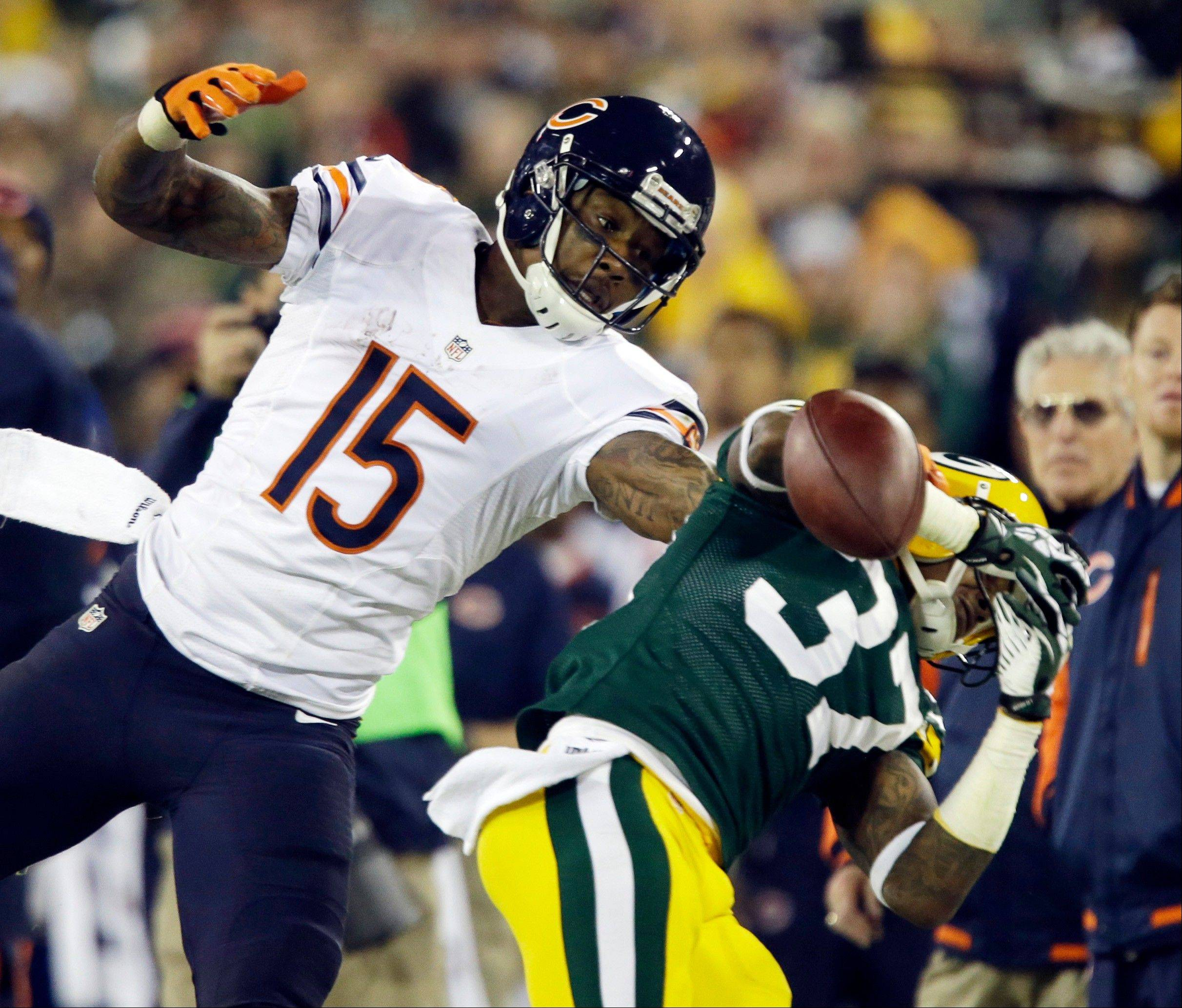 Green Bay Packers' Sam Shields breaks up a pass intended for Chicago Bears' Brandon Marshall (15) during the second half .