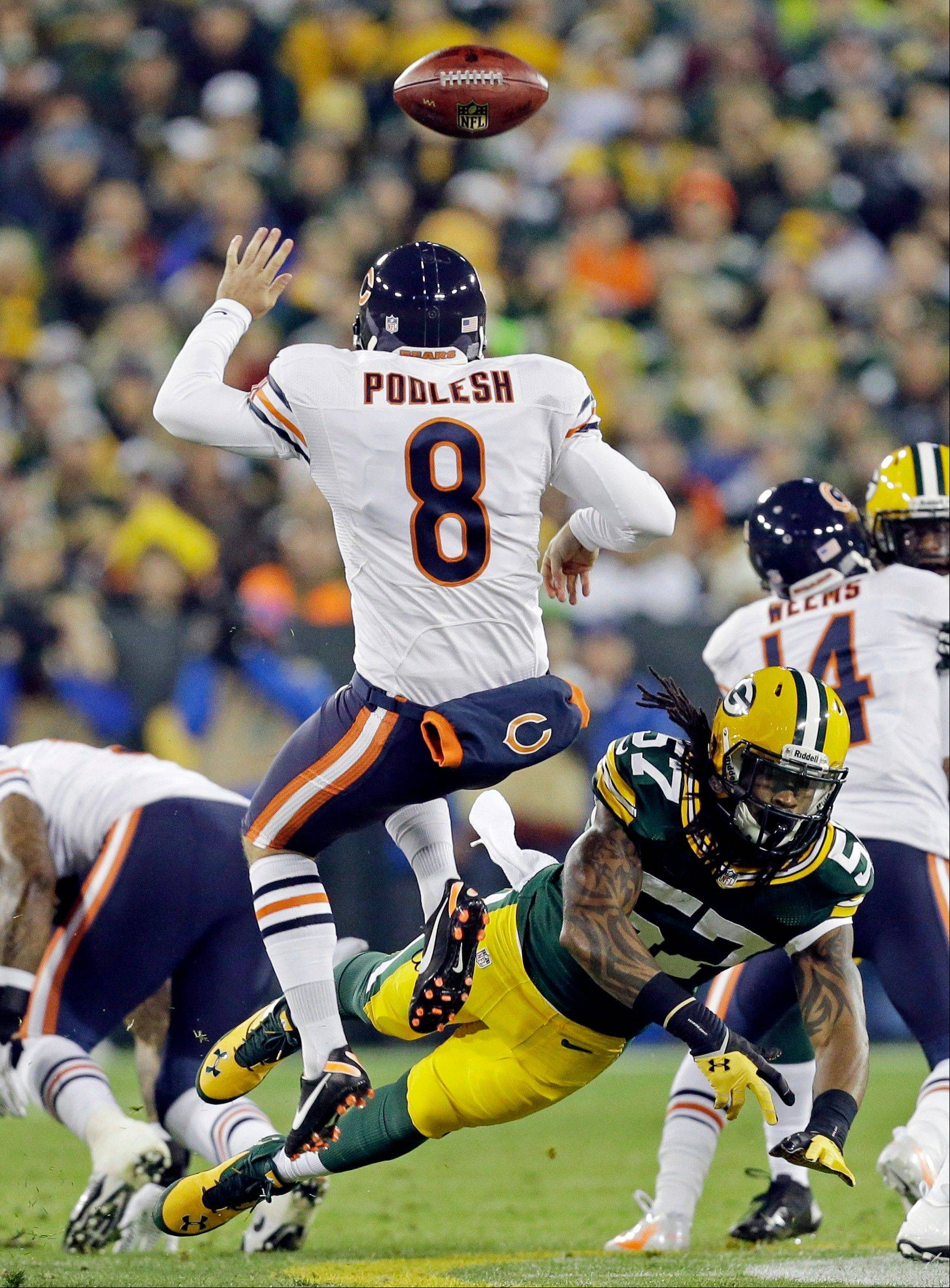 Green Bay Packers' Jamari Lattimore (57) blocks the punt of Chicago Bears' Adam Podlesh (8) during the first half .