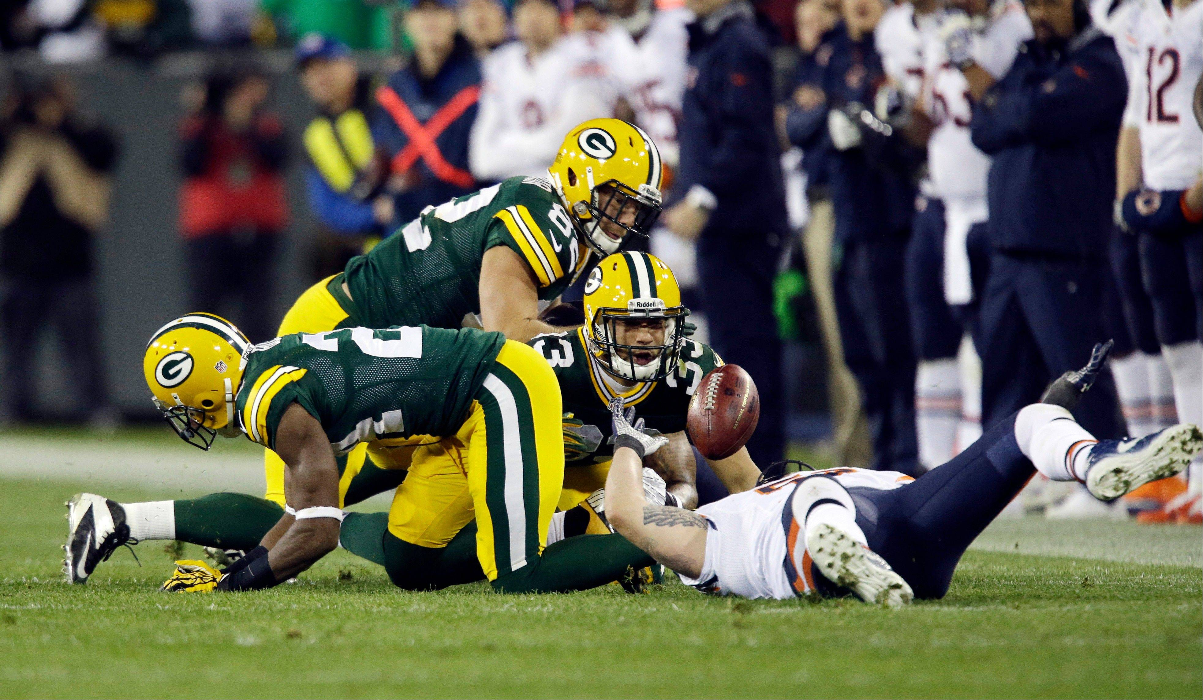 Players scramble for a loose ball on an on side kick during the second half of an NFL football game between the Green Bay Packers and the Chicago Bears Monday, Nov. 4, 2013, in Green Bay, Wis. The Packers recovered the ball.