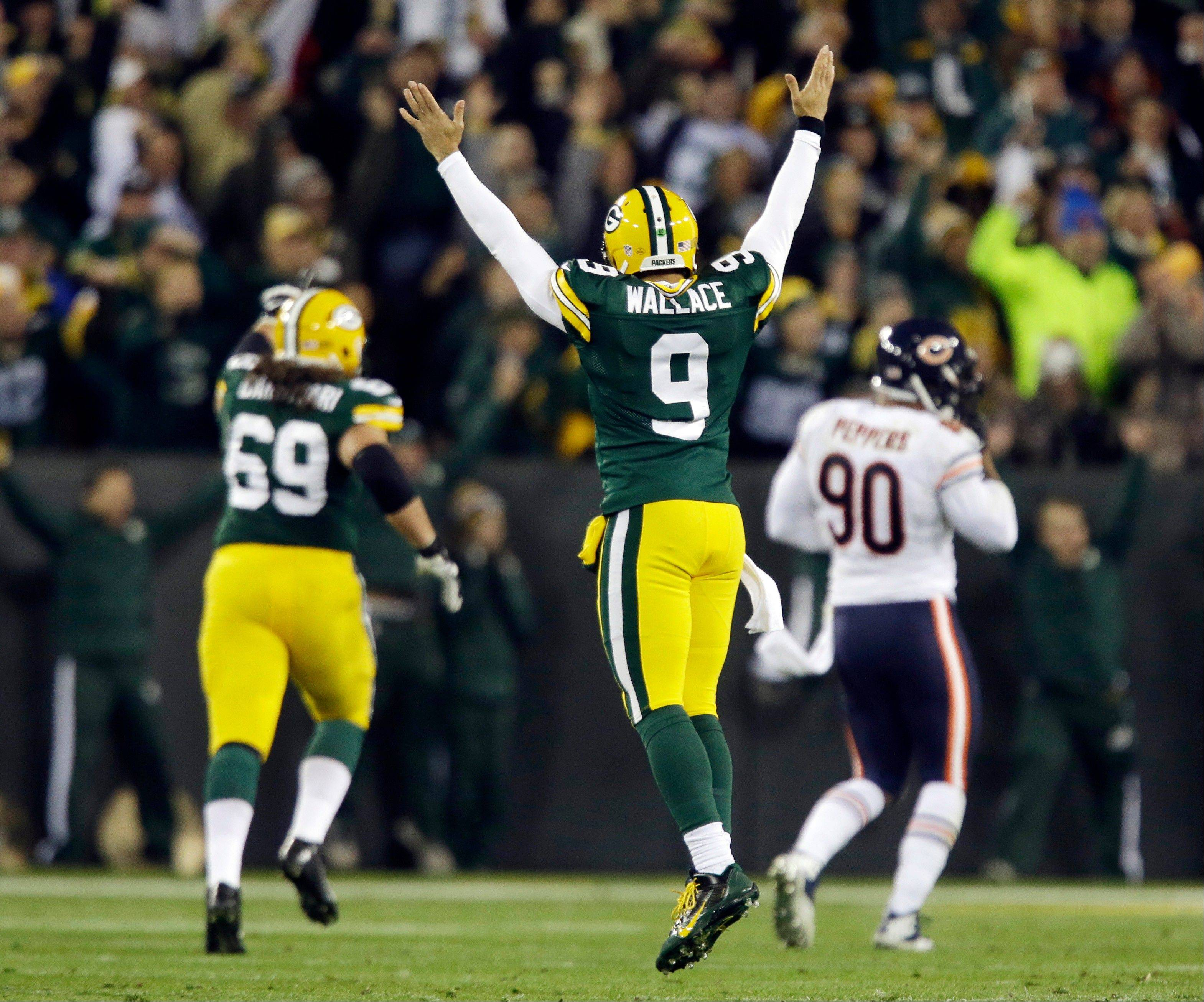 Green Bay Packers quarterback Seneca Wallace reacts after James Starks' 32-yard touchdown run during the first half.