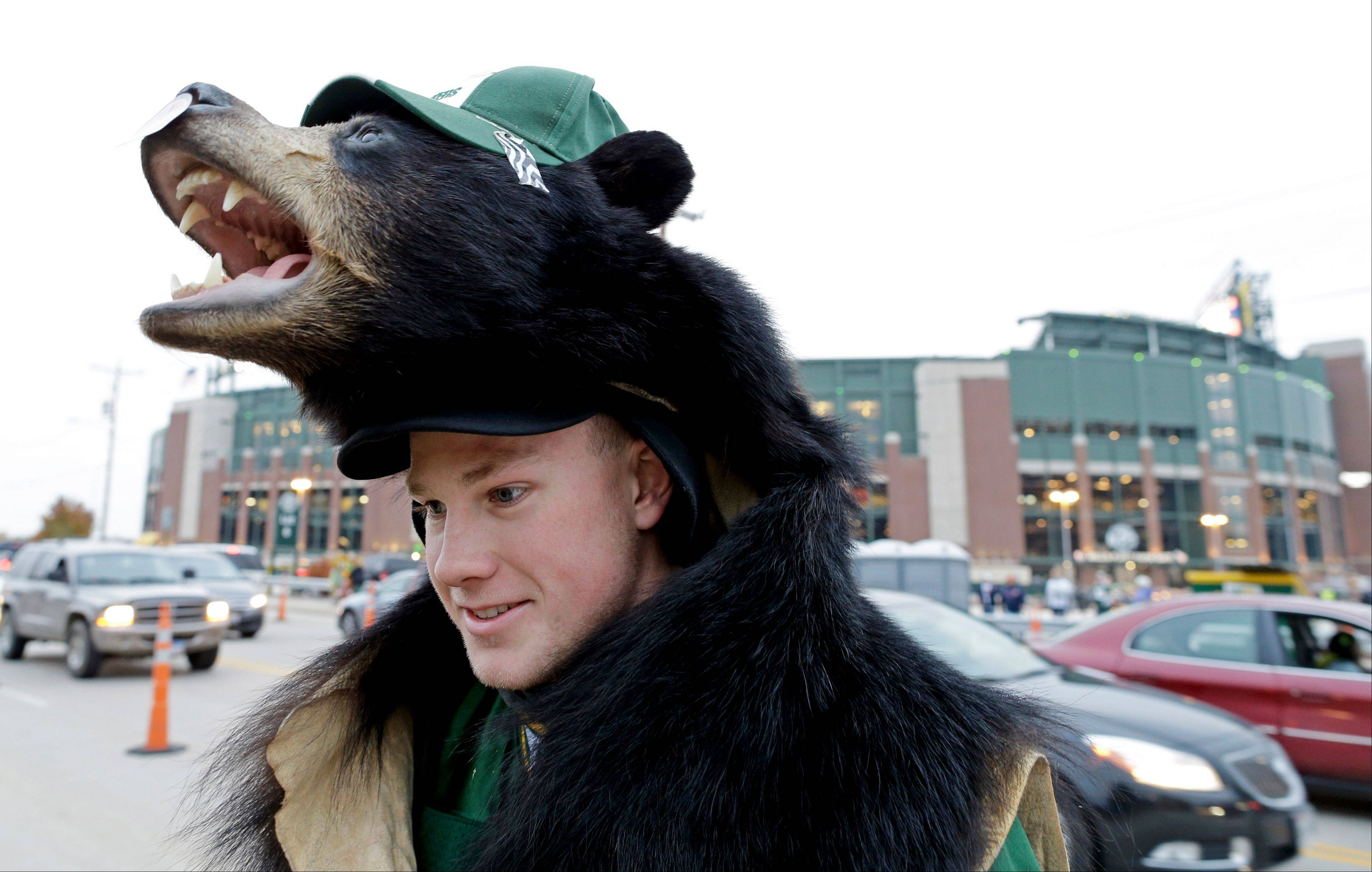 Green Bay Packers fan Thorton Gressler wears a bear hat.