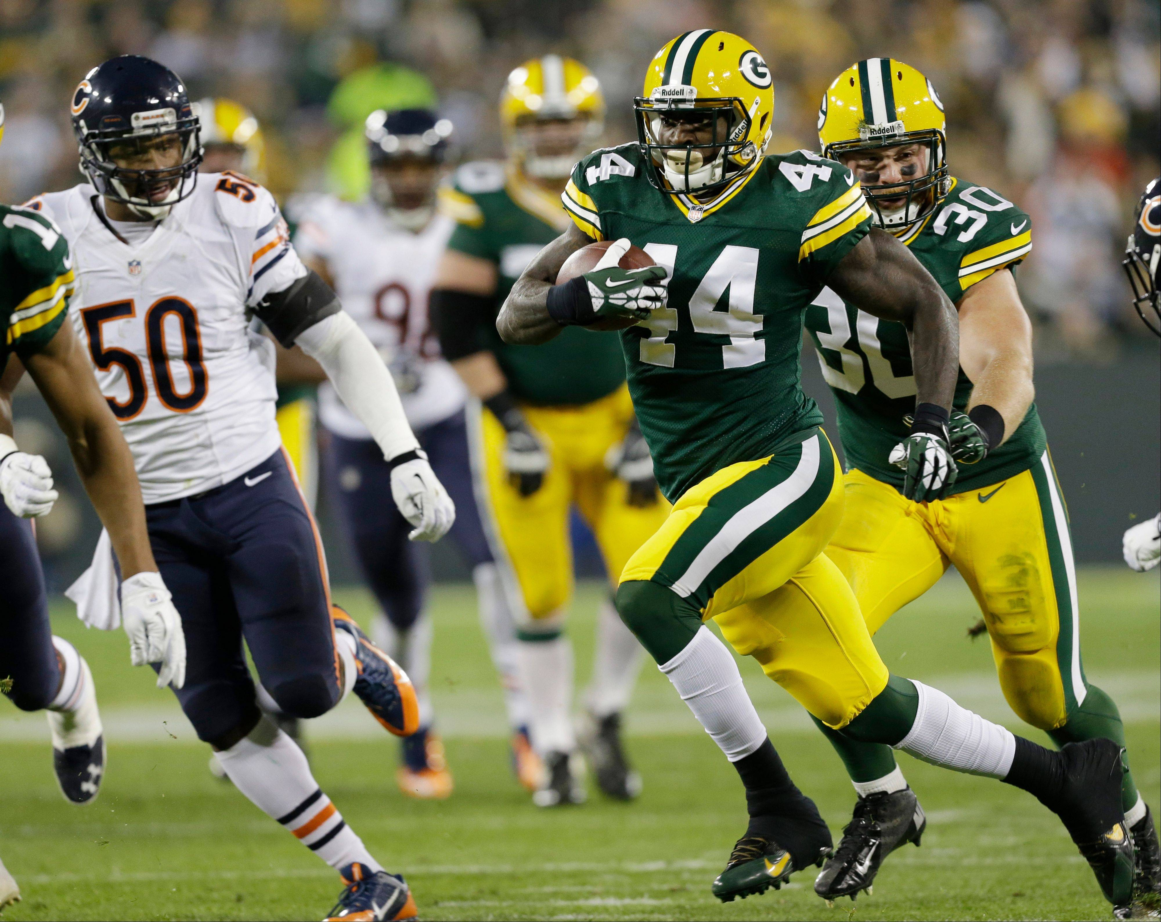 Green Bay Packers' James Starks (44) breaks away for a 32-yard touchdown run during the first half.