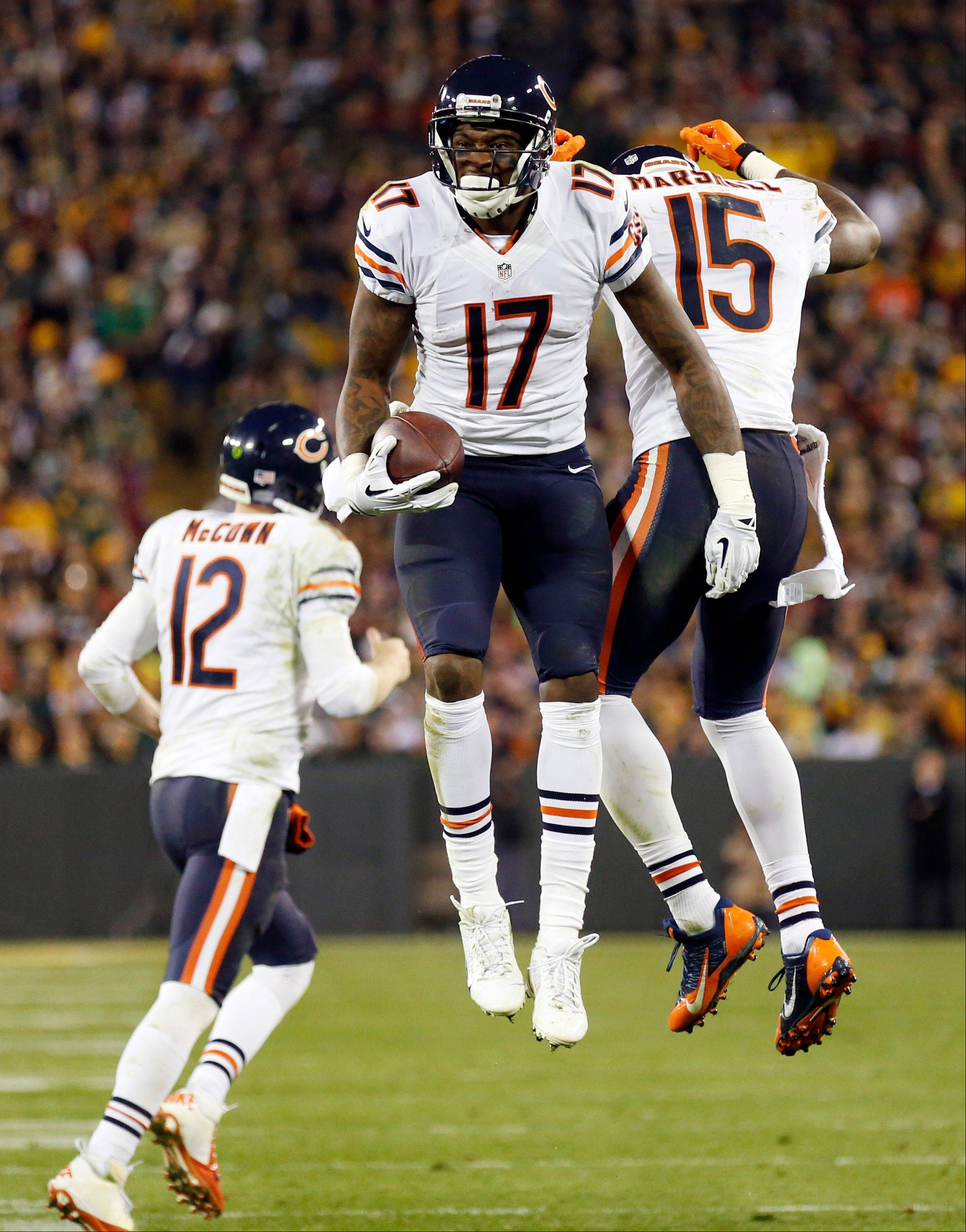 Chicago Bears' Brandon Marshall (15) celebrates one of his touchdown catches with teammates Alshon Jeffery (17) and Josh McCown (12) during the second half.