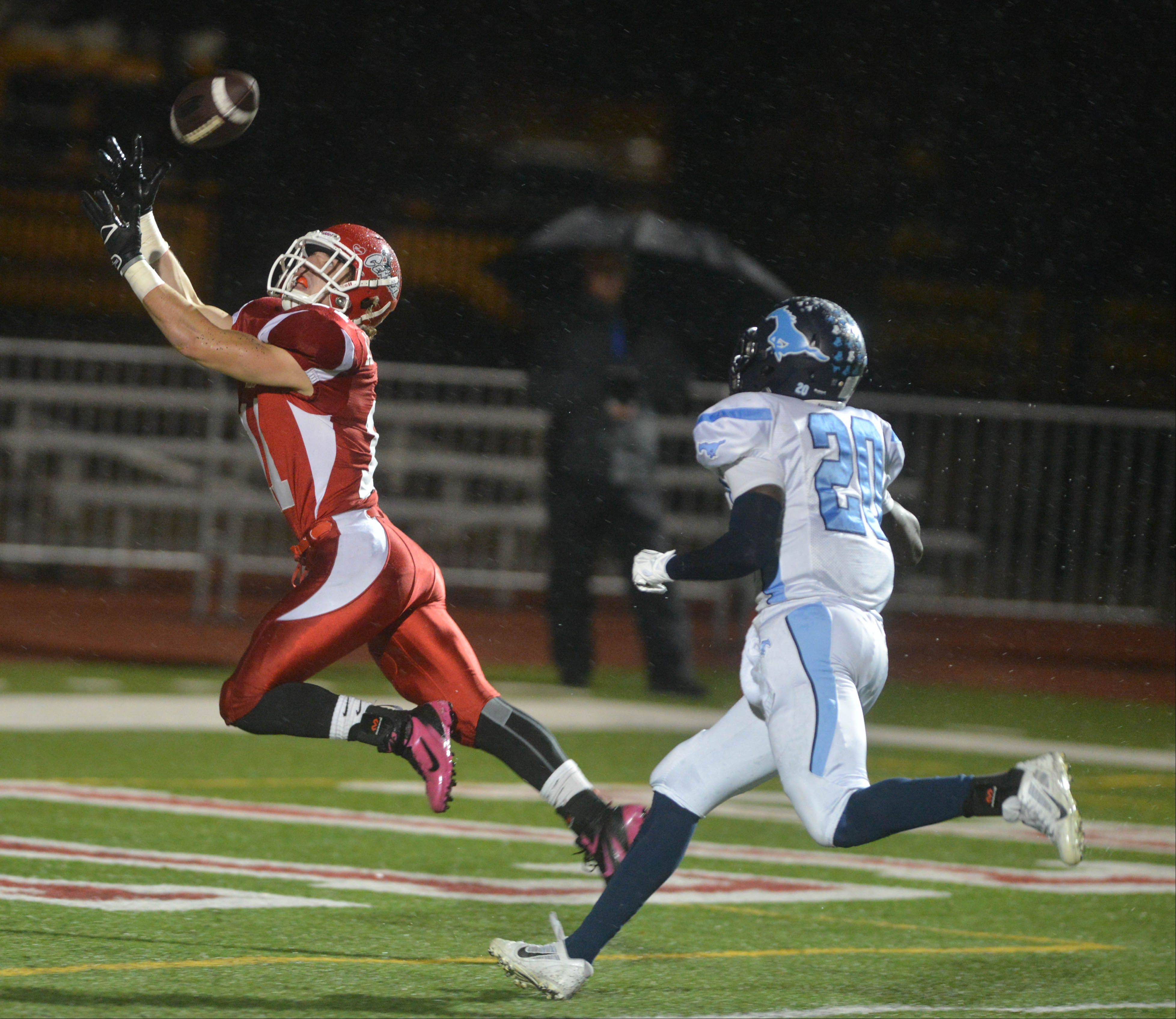 Naperville Central's Ben Andreas reaches for the ball during Friday's playoff game against Downers Grove South.