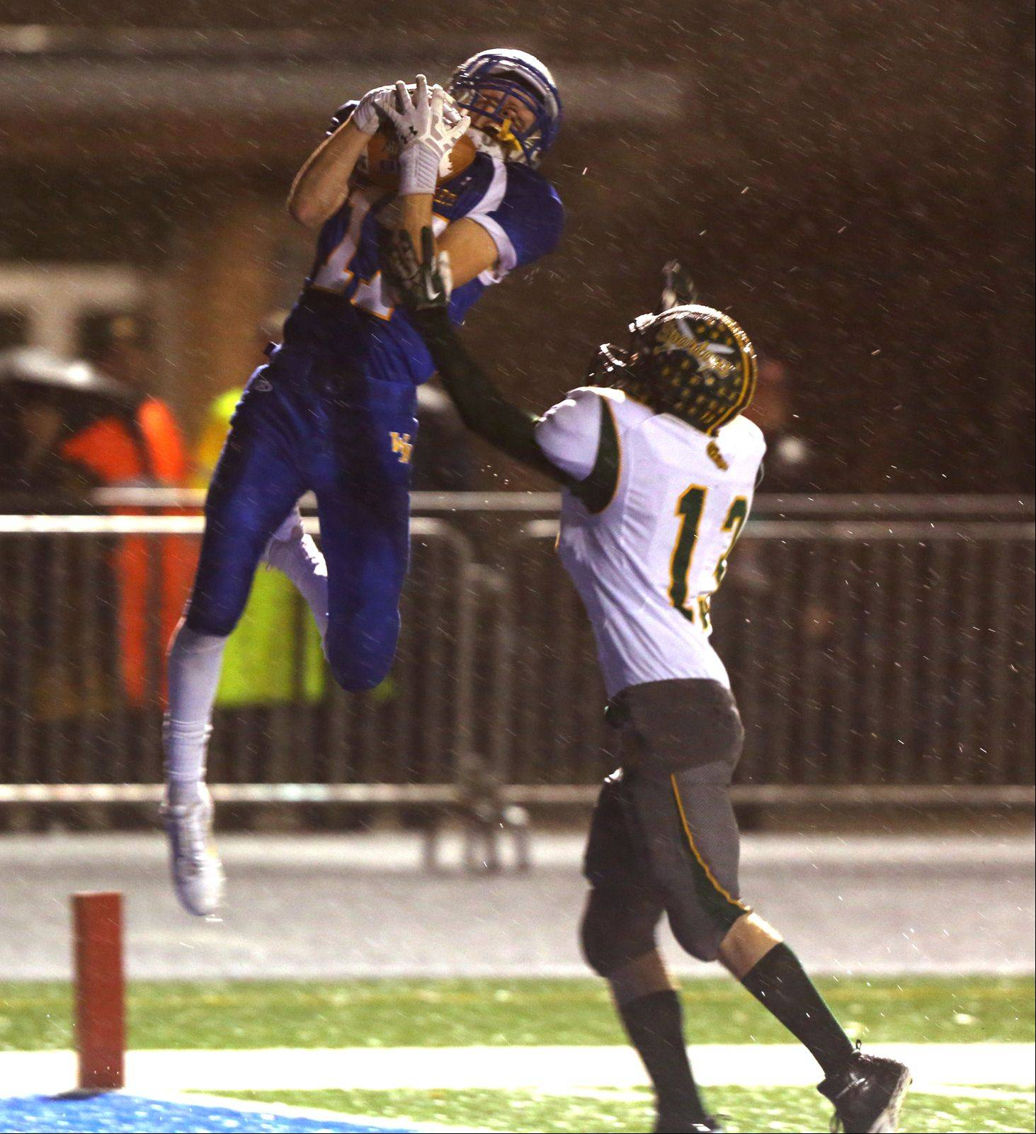 Wheaton North's Michael Bloss, left, makes a catch over Glenbrook North's Brice Call for first-half touchdown Friday.