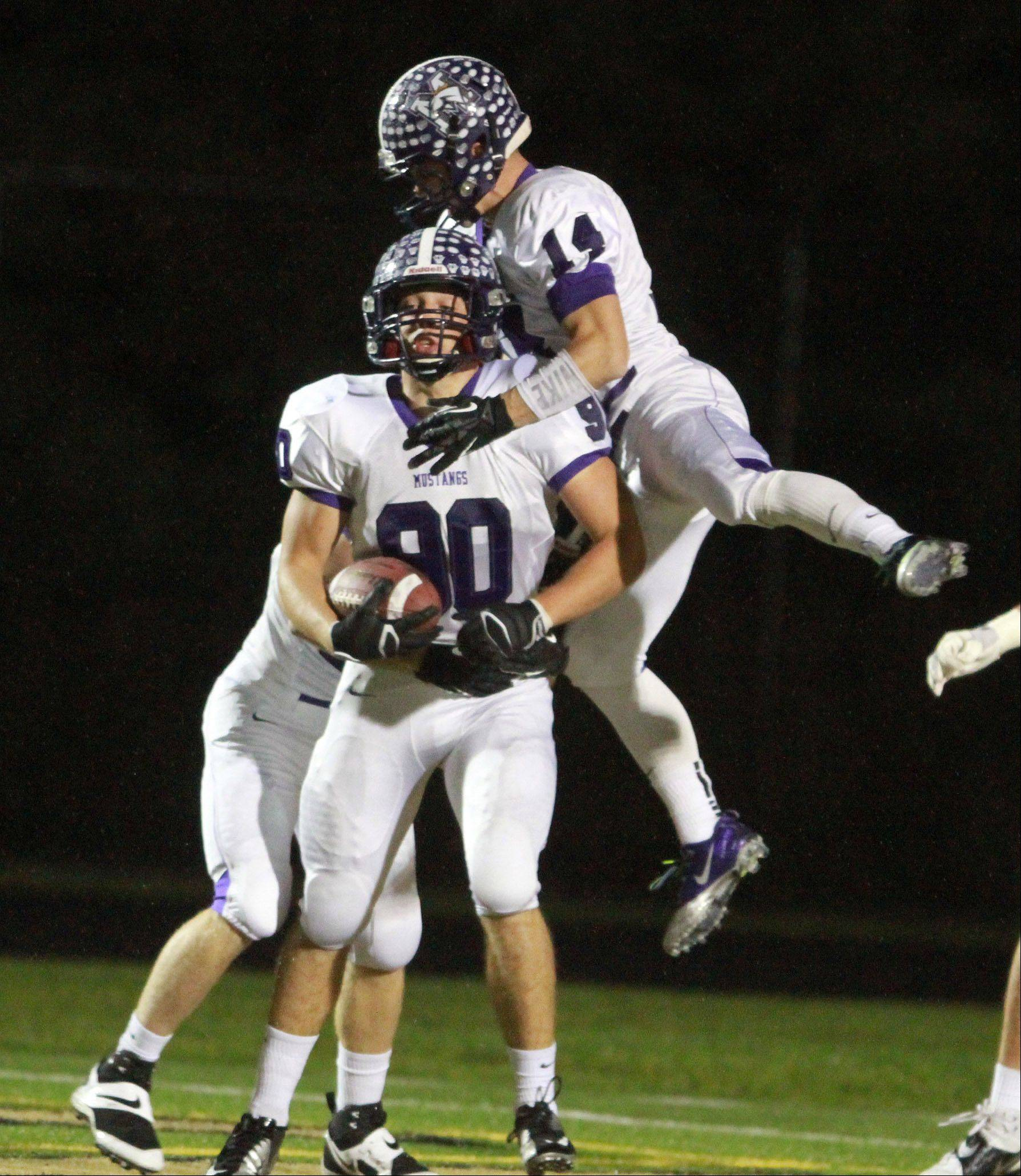 Rolling Meadows' Matt Campbell, left, and Alex Niecikowski celebrate Campbell's touchdown against Grayslake North Friday.