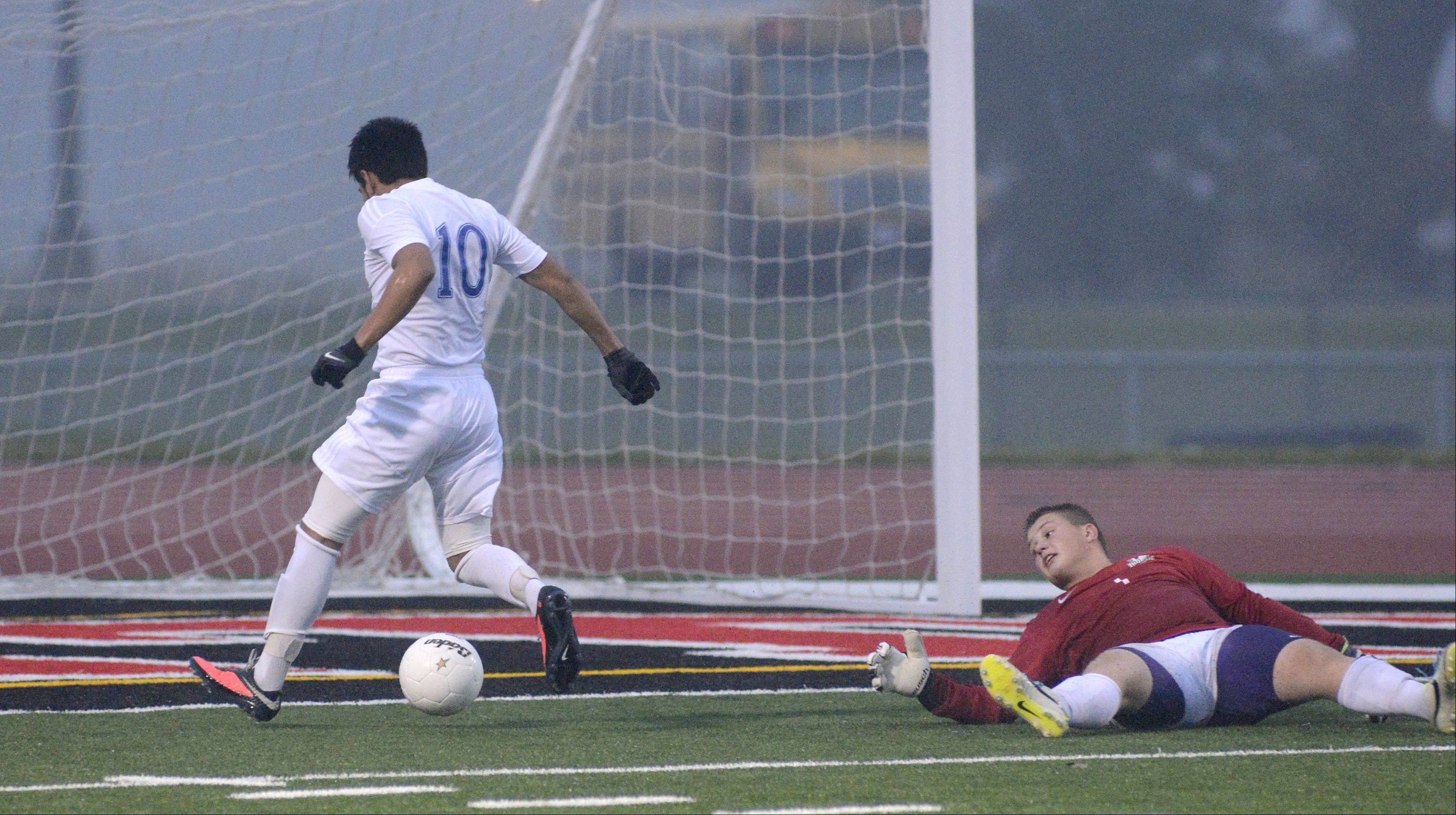 Larkin's Gonsalo Garcia trots past Hononegah goalie Henry Reynolds to score an easy goal Wednesday in Huntley.
