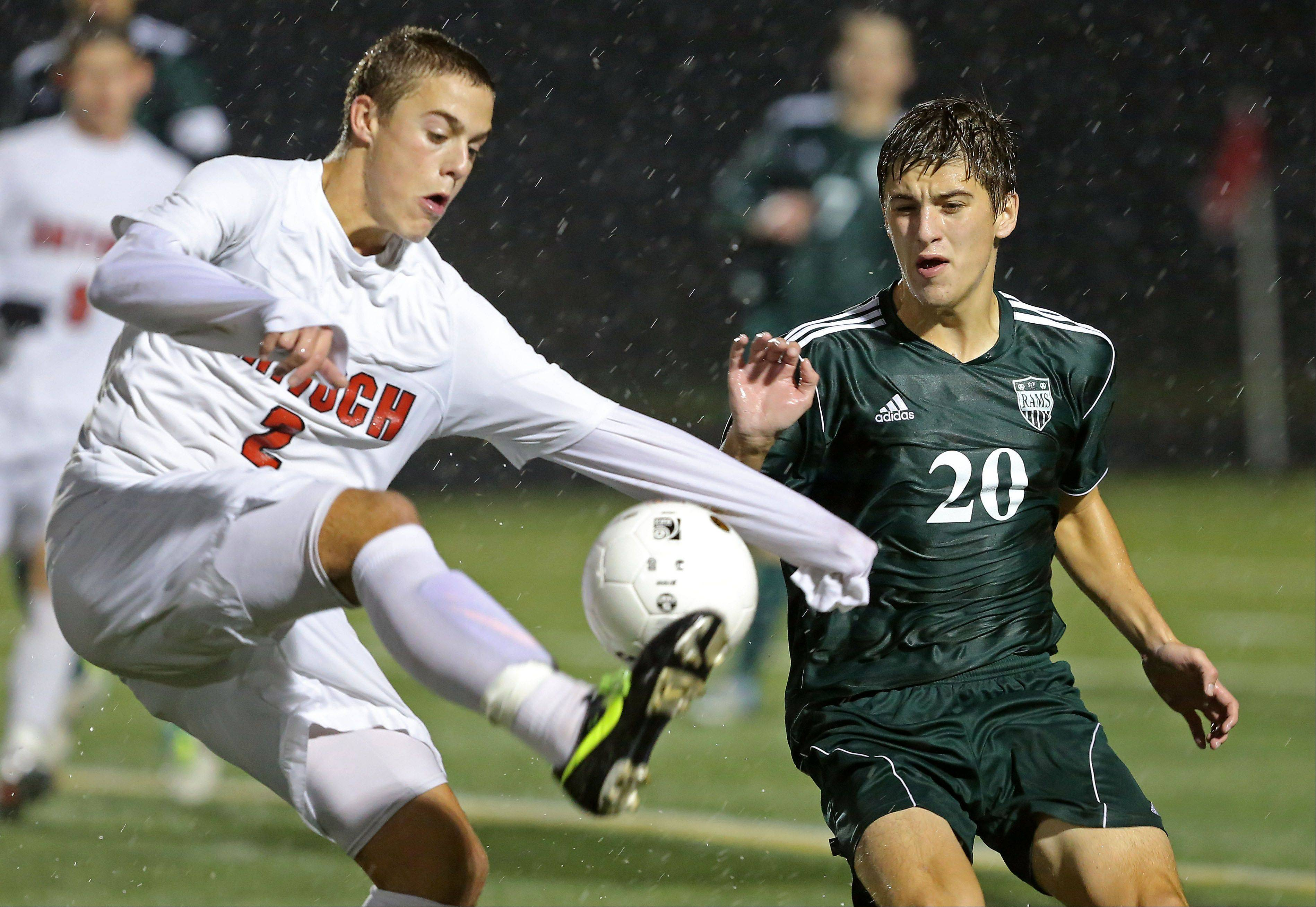Antioch's Eric Pedersen, left, tries to gain control of the ball ahead of Grayslake Central's Paul Kulis during Wednesday's Class 3A sectional soccer semifinal in Grayslake.