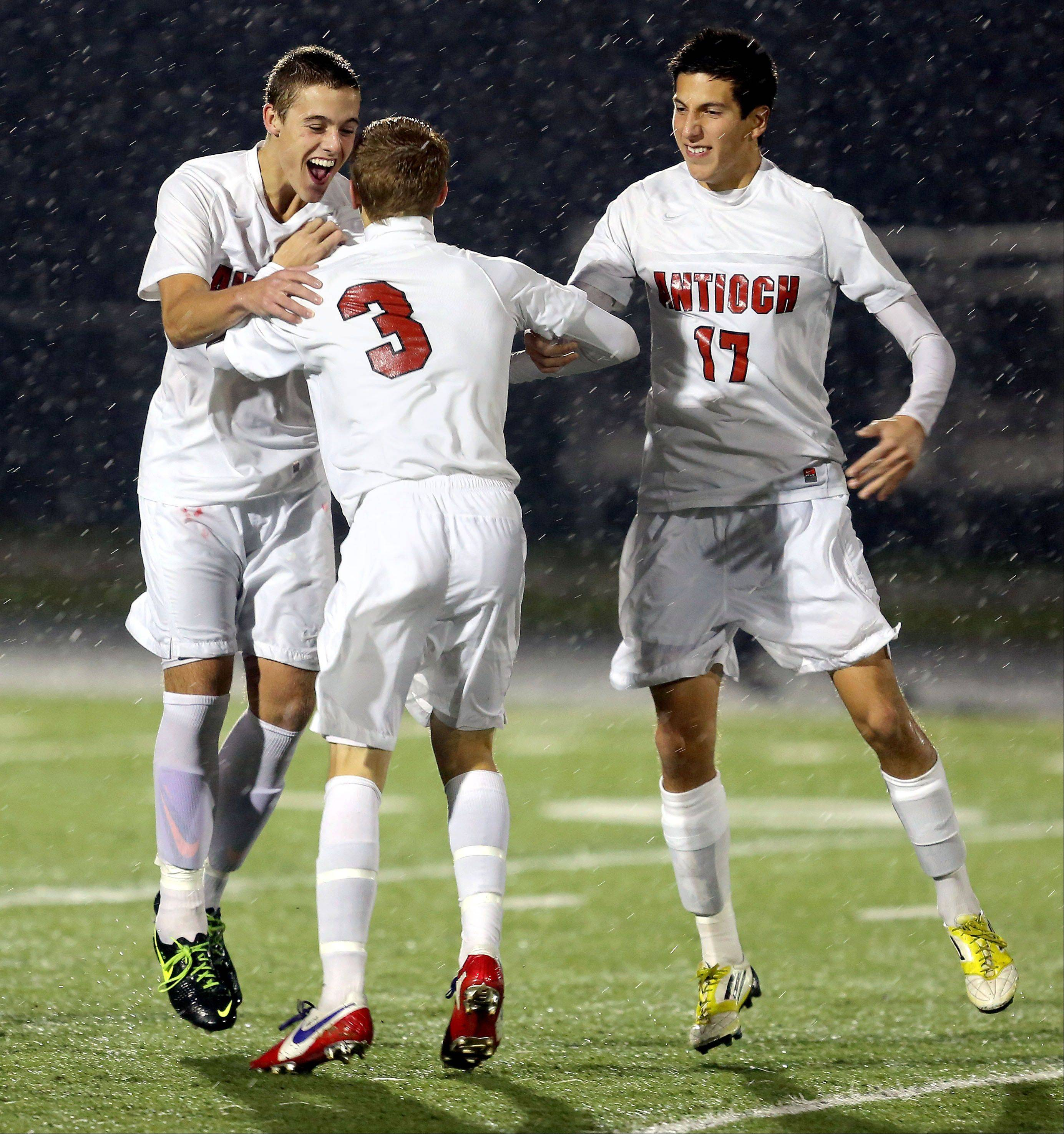 Antioch's Eric Pedersen, left, and RJ Ruano celebrate with Danny Brito (3) after a goal Wednesday.