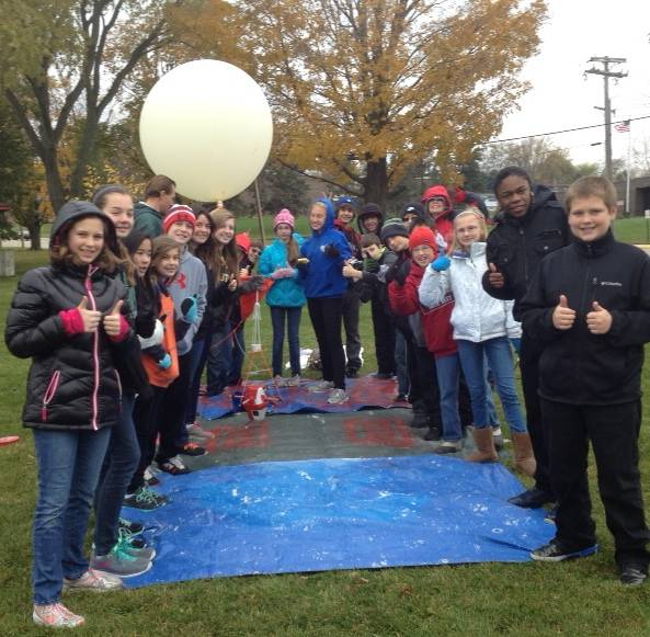 A team of middle school students and teachers from Holy Family Catholic Academy (Inverness) eagerly await the launch of their High Altitude Weather Balloon.