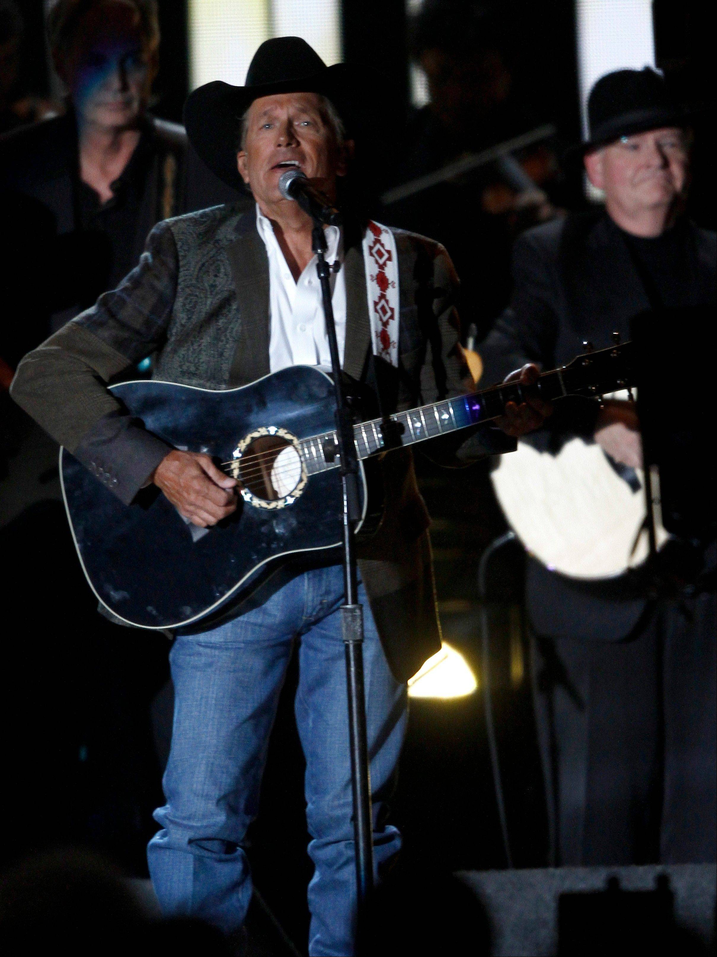 George Strait was named Entertainer of the Year at the 47th annual CMA Awards Wednesday night in Nashville.