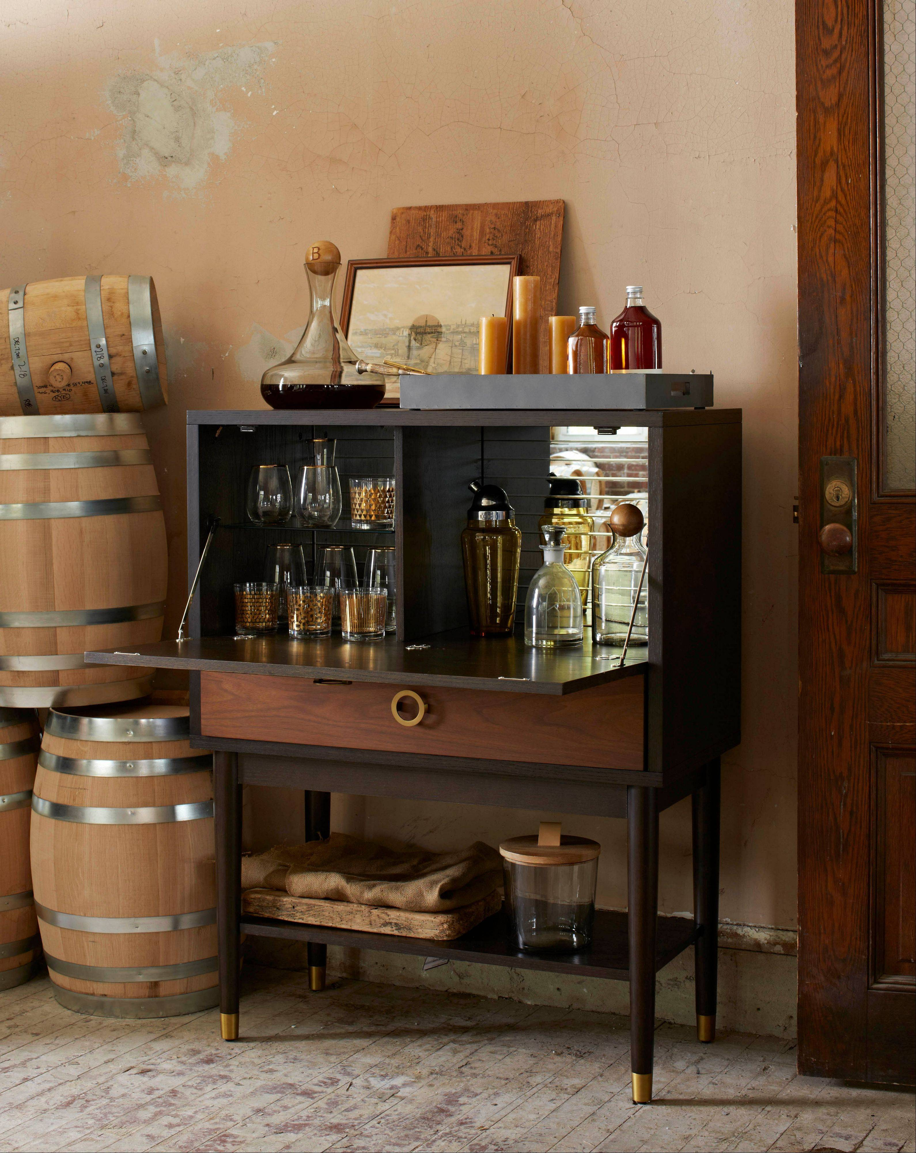 The Dodson bar has flip-down shelves and lots of storage. Bar carts are a great way to set up a bar in a small space.