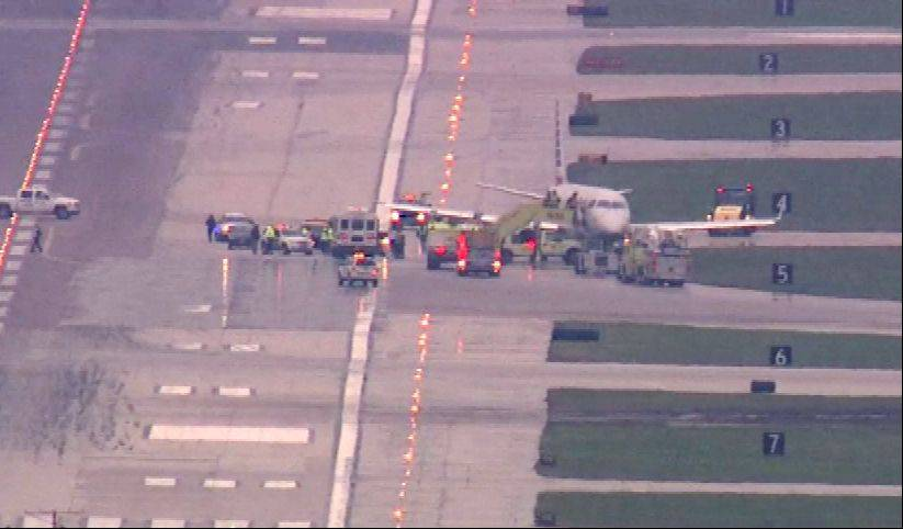 Photo courtesy of ABC 7 Chicago Chicago firefighters assist at O�Hare International Airport Wednesday morning where a plane skidded off a runway.