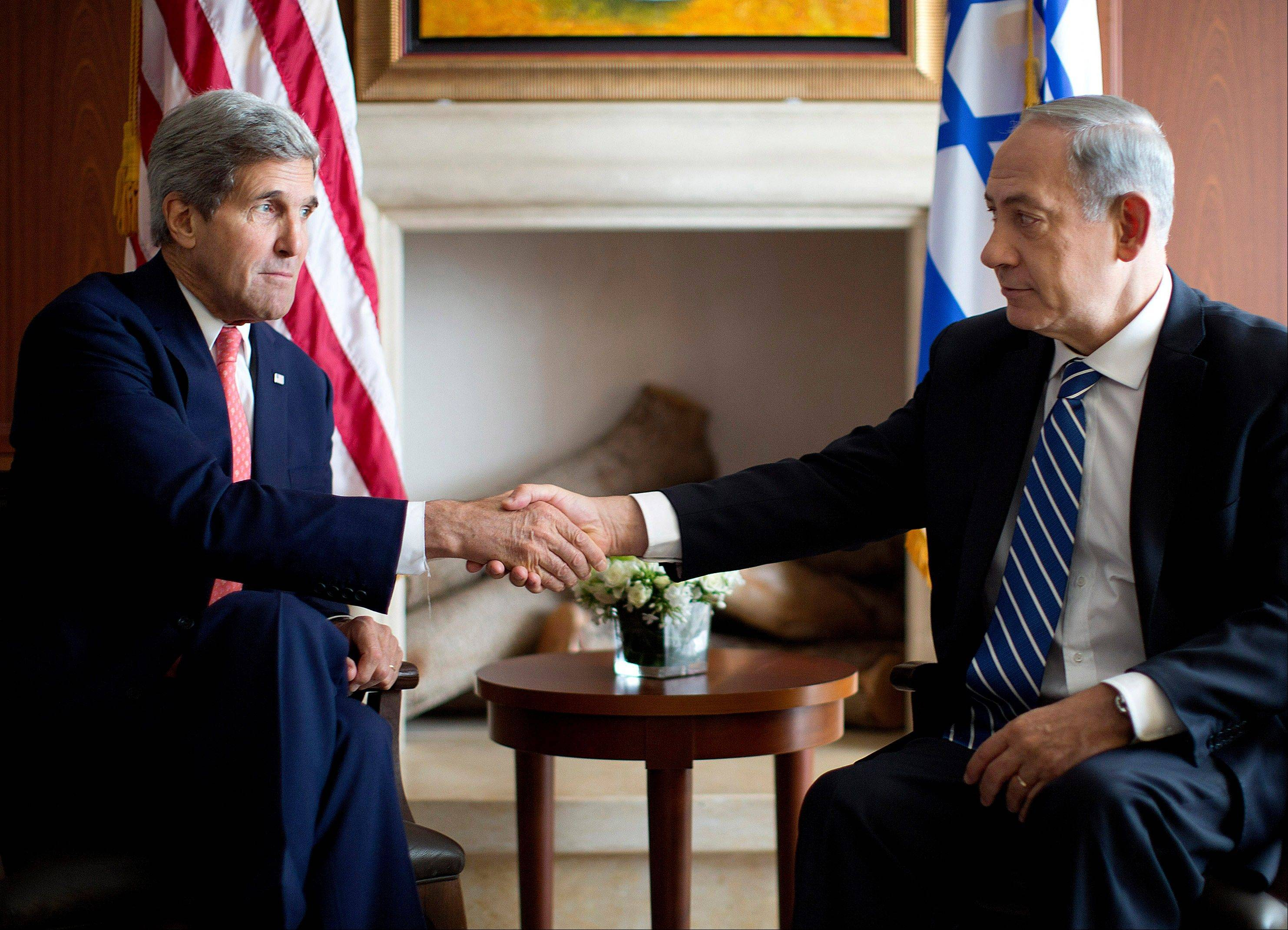 U.S. Secretary of State John Kerry, right, shakes hands with Israeli Prime Minister Benjamin Netanyahu in Jerusalem, Wednesday, Nov. 6, 2013.