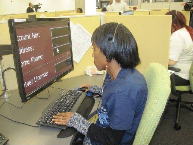 Megan Craig, a visually impaired worker at the Illinois State Toll Highway Authority's new customer call center, uses special technology to enlarge records of an I-PASS customer with a question.