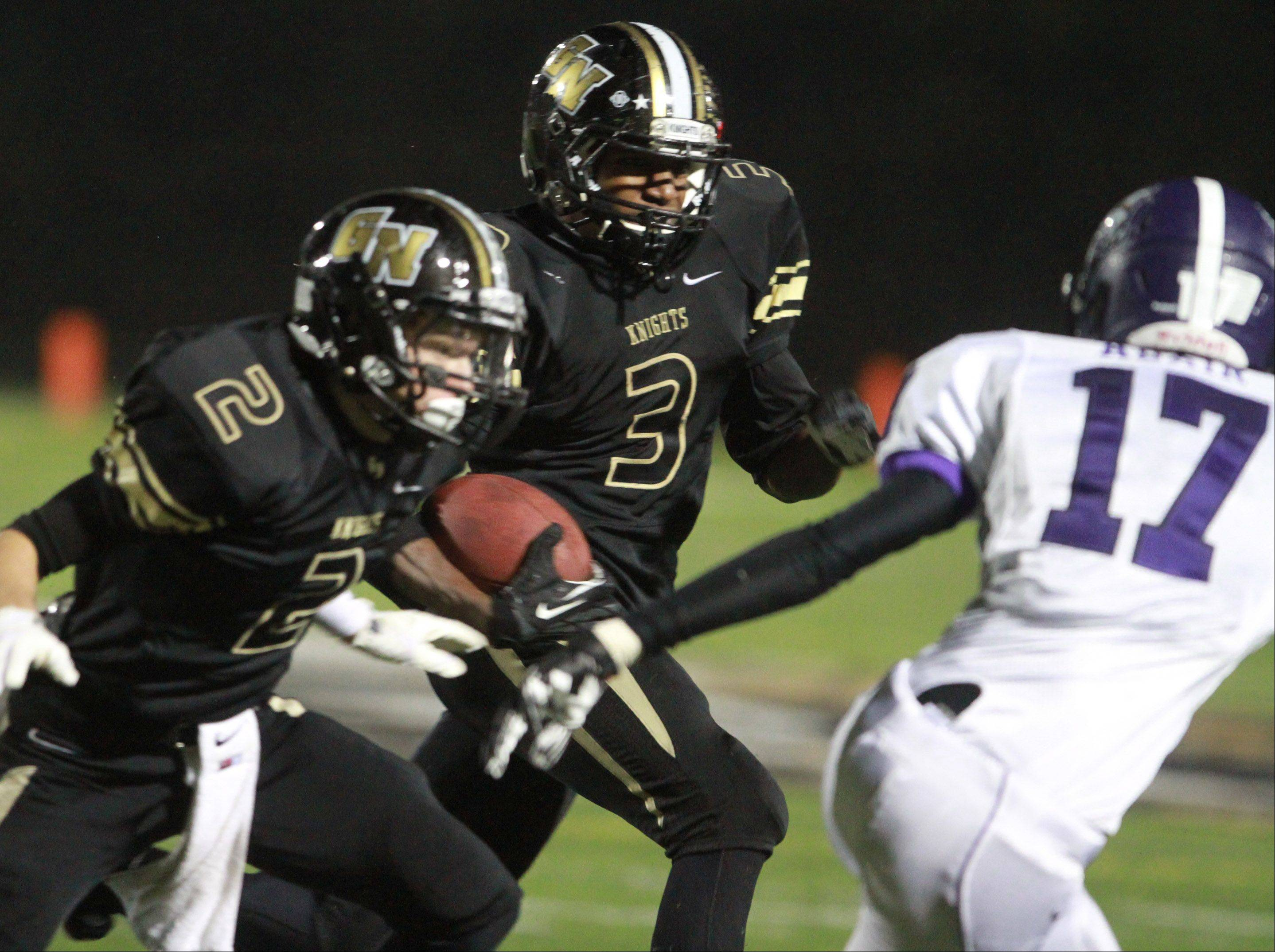 Grayslake North�s Titus Booker looks for running room as Dylan Foster (2) looks to block a defender against Rolling Meadows last Friday night.