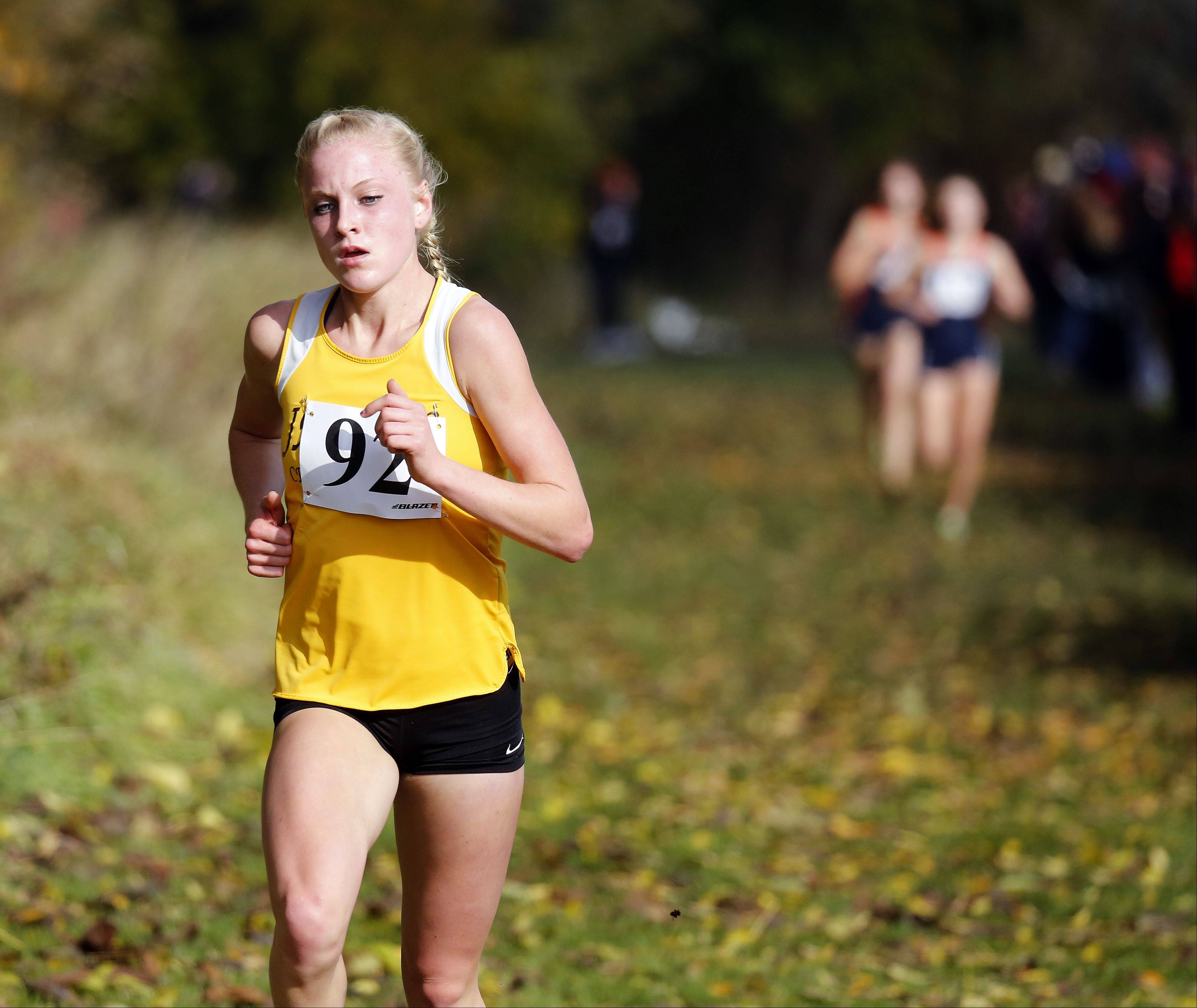 Jacobs� Lauren Van Vlierbergen heads to first place at the Waubonsie Valley girls cross country sectional in Aurora last Saturday.