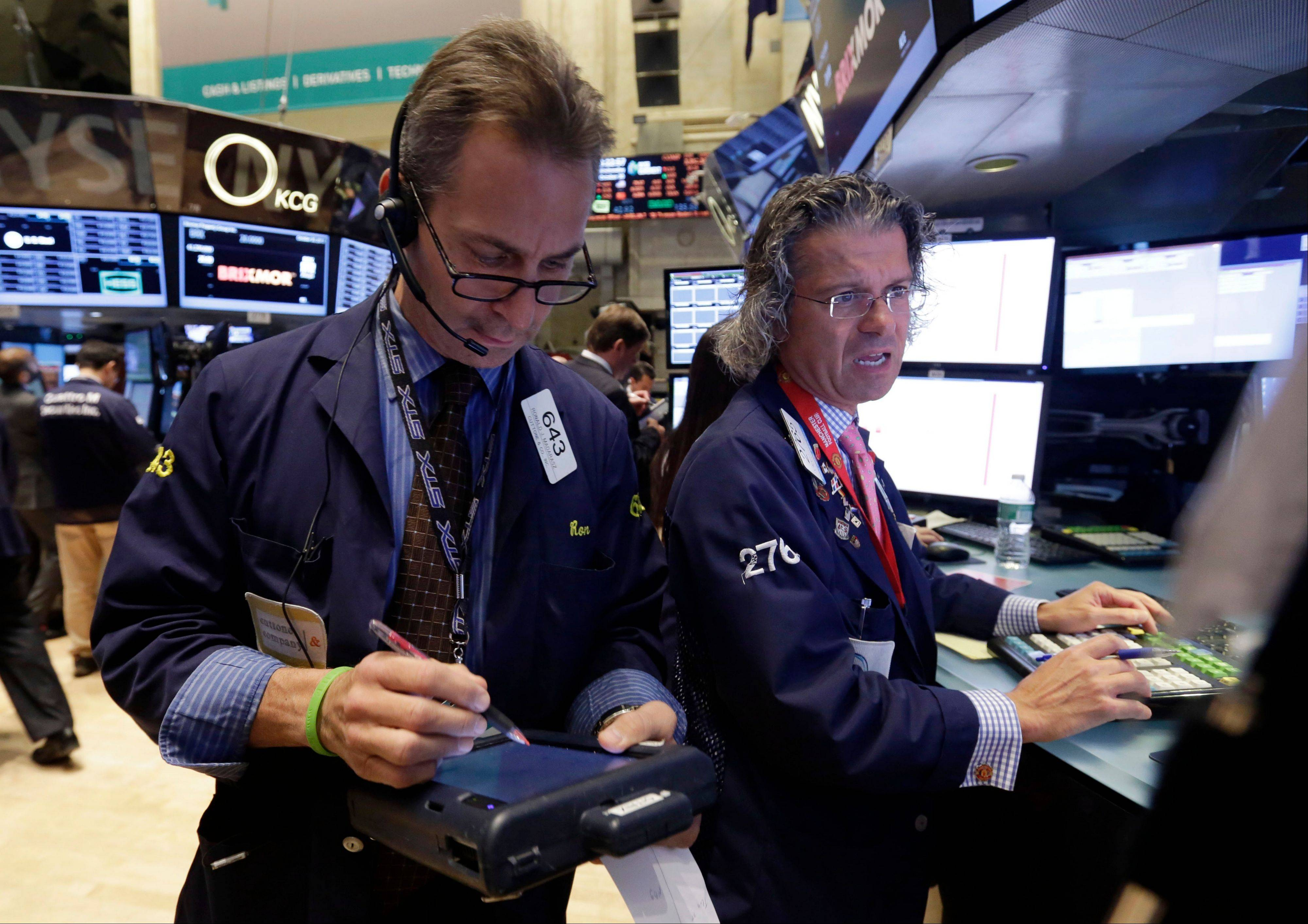 U.S. stocks advanced Wednesday, sending the Dow Jones Industrial Average to a record close, as Federal Reserve officials said economic weakness warrants continued stimulus and investors await data this week on jobs and growth.