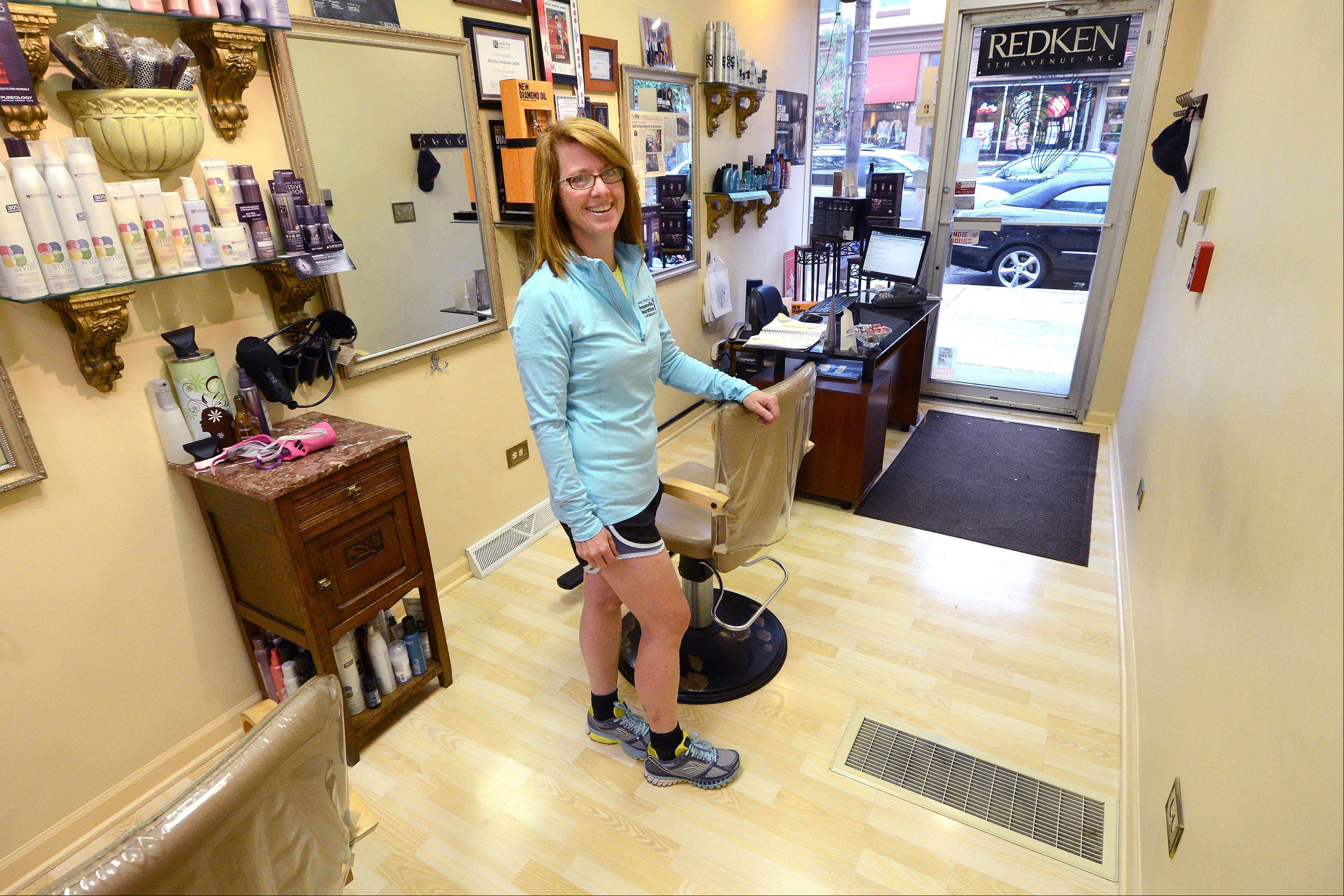 Terri Hayes, owner of Artistic Creations Salon in downtown Naperville, is running the Naperville Half Marathon on Sunday along a route that starts and finishes not far from her salon's location. Business operators wanted the race to incorporate the downtown to bring runners and fans to the area to shop and dine.