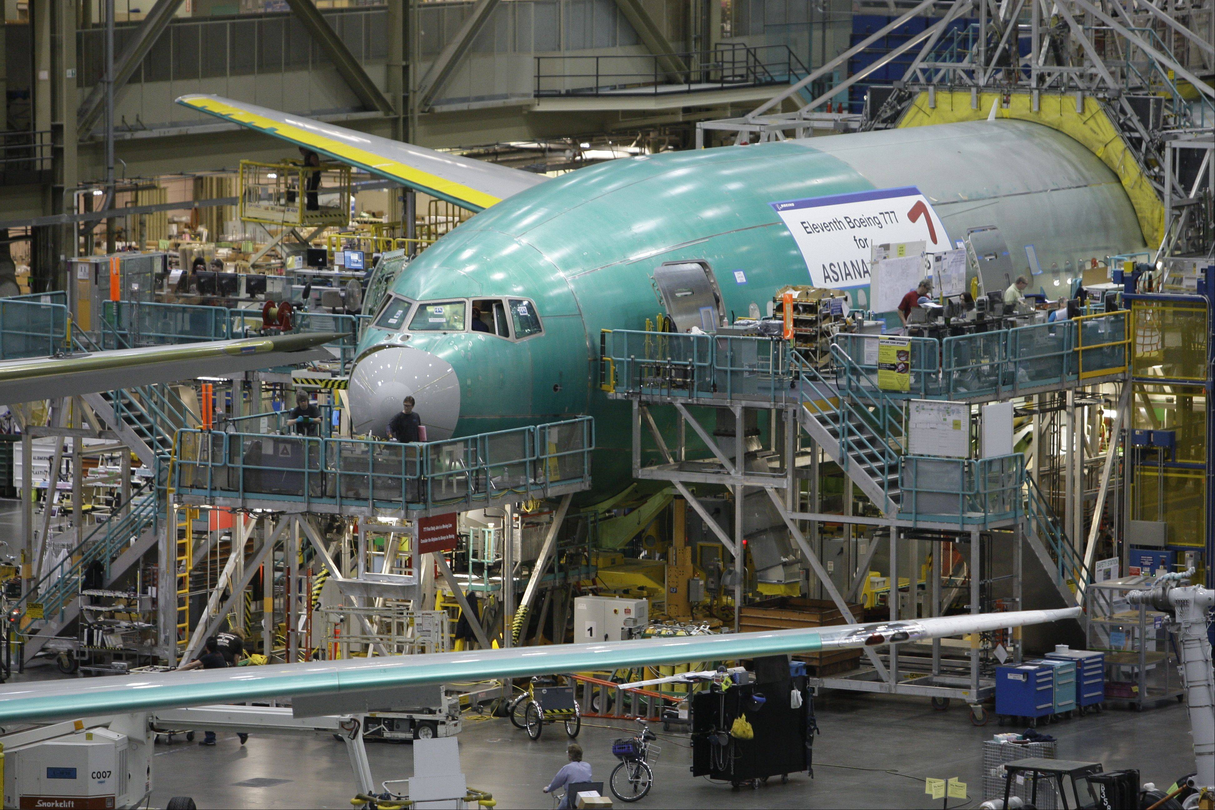 In this Feb. 3, 2010 photo, a Boeing Co. 777 jetliner on the production line in Everett, Wash.