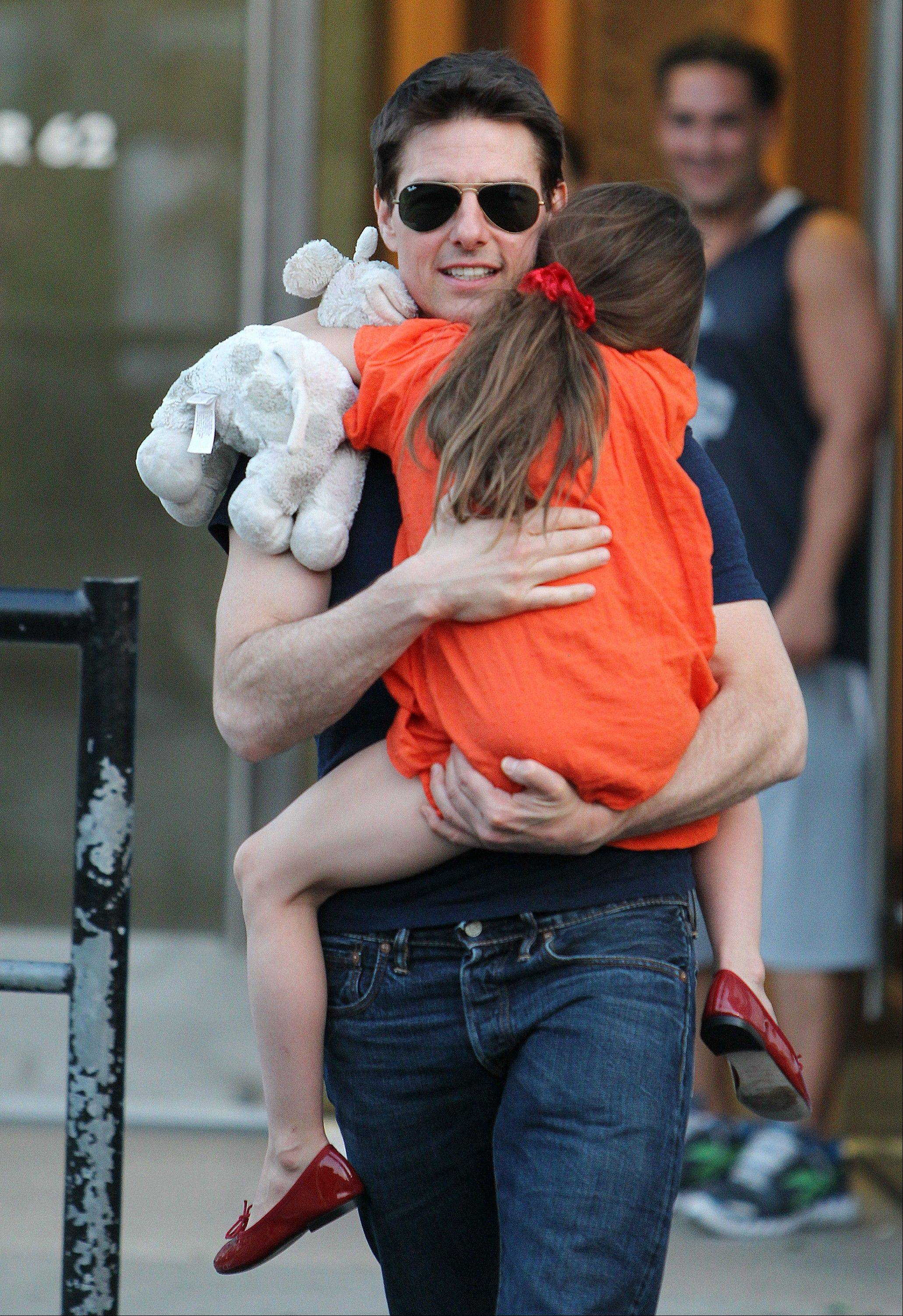 "Actor Tom Cruise wrote in a sworn declaration filed in a defamation lawsuit against Bauer Publishing Co. that he maintains a close relationship with his daughter Suri despite the claims by two Bauer tabloids in 2012 that he had ""abandoned"" her."