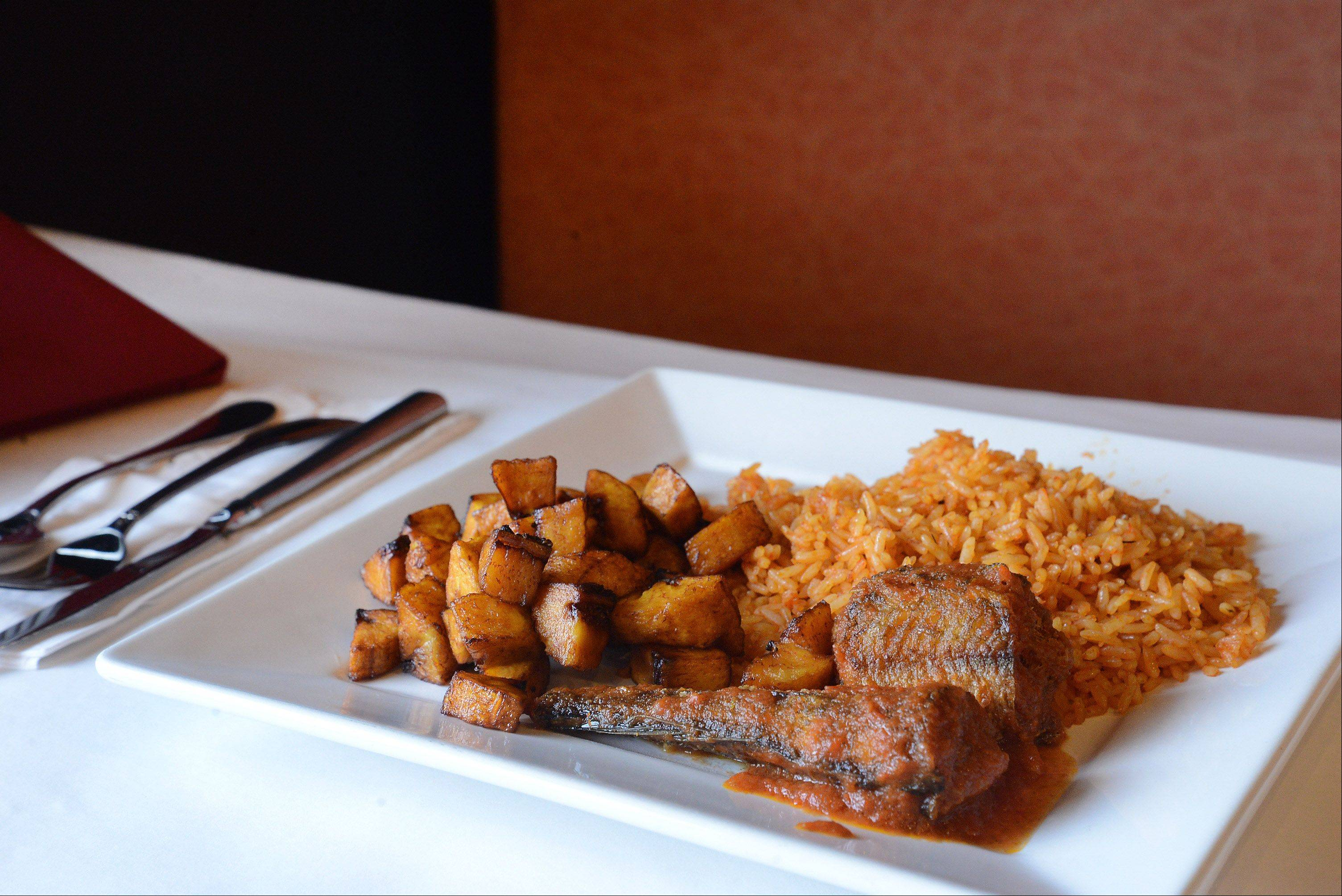 Jallof rice comes with a side of plantains at Bisi African Restaurant in Schaumburg.