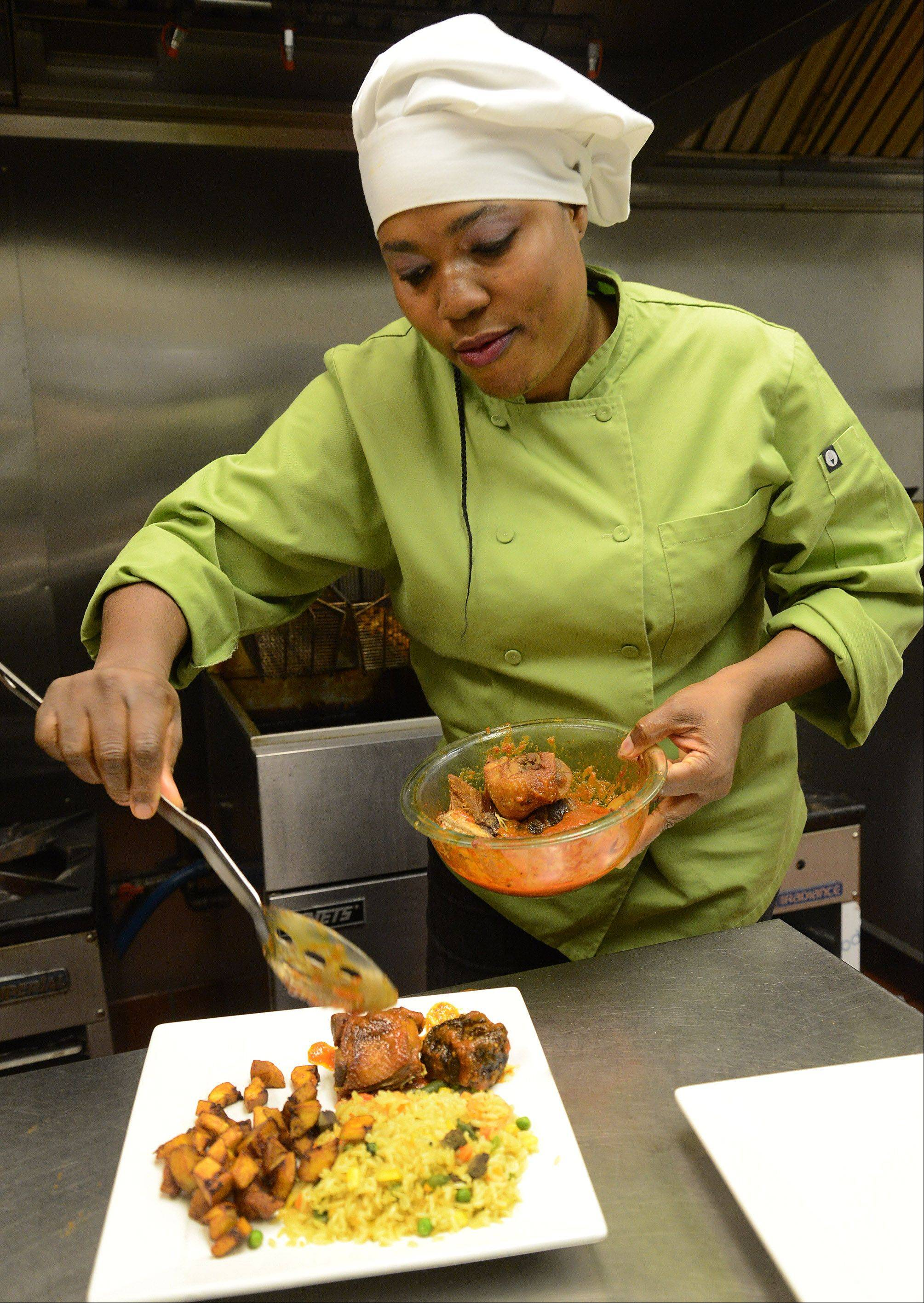 Chef Bisi Agaba dishes up fried rice with beef liver, beef, chicken and plantains at her namesake restaurant in Schaumburg.