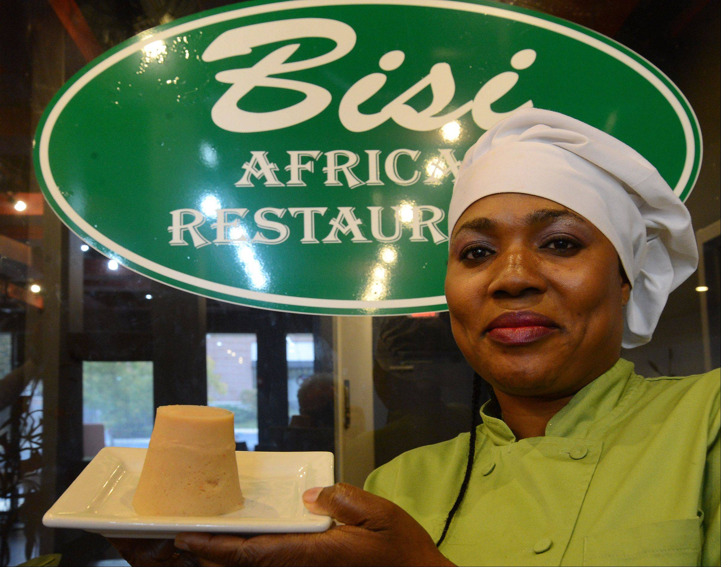 Chef Bisi Agaba shows off the bean cake (moi-moi) she makes at Bisi African Restaurant in Schaumburg.