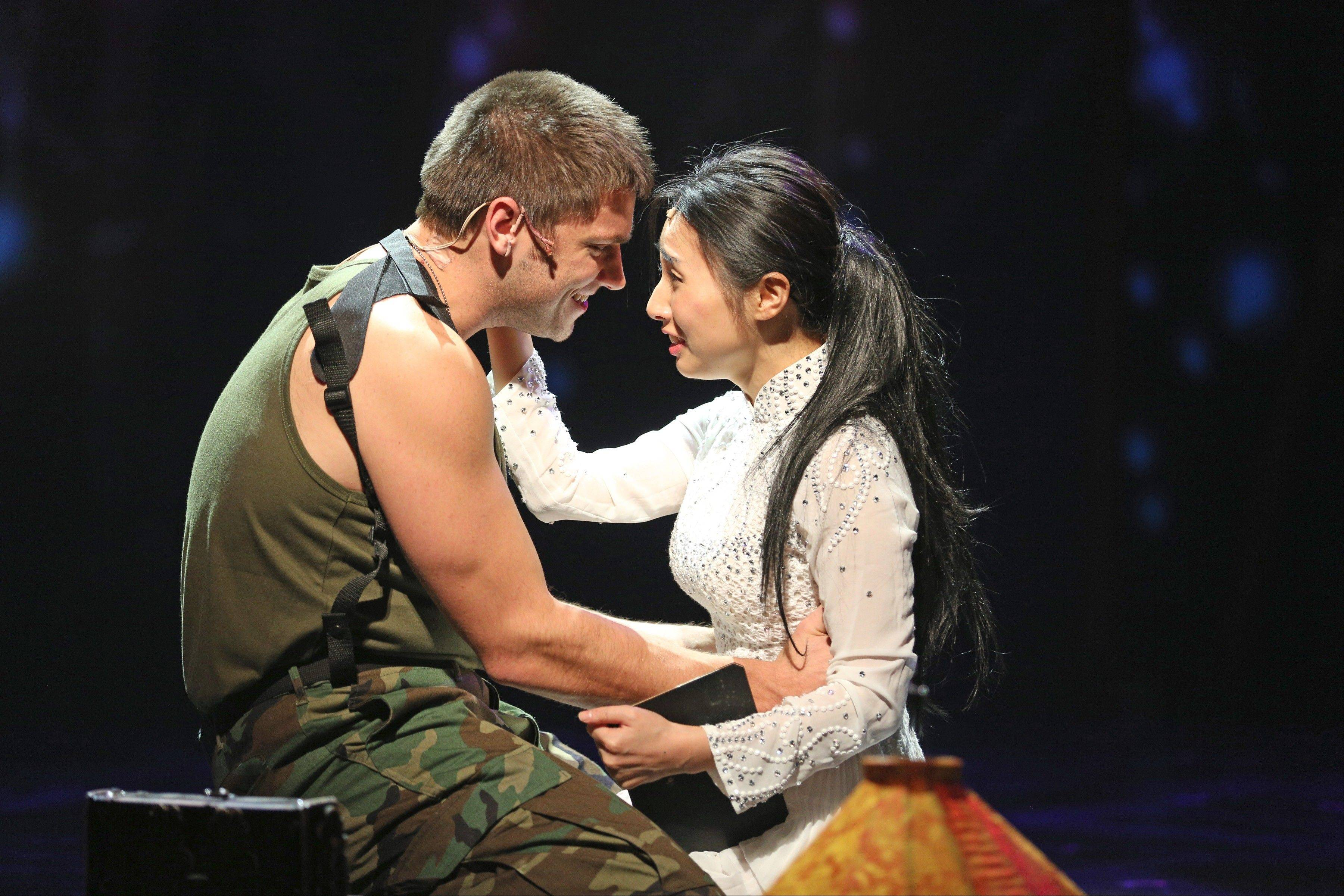 "The American soldier Chris (Brandon Moorhead) and the recently orphaned Kim (Shawna Haeji Shin) declare their love for each other in the song ""The Last Night of the World"" in the Paramount Theatre's production of ""Miss Saigon,"" playing now through Sunday, Nov. 24, in Aurora."