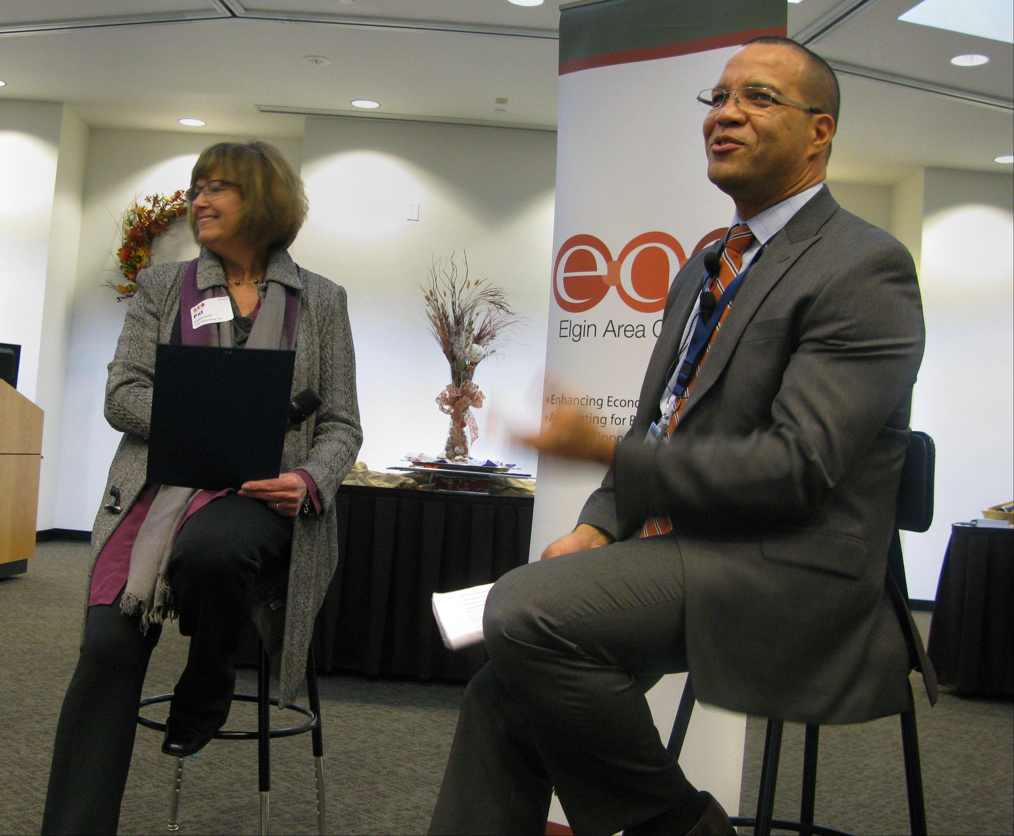 "Elgin Area School District U-46 Superintendent José M. Torres responds to questions asked by Pat Szpekowski Wednesday at the Elgin Chamber of Commerce's ""CEO Unplugged: A Personal Look at the Leader"" series at Elgin Community College."