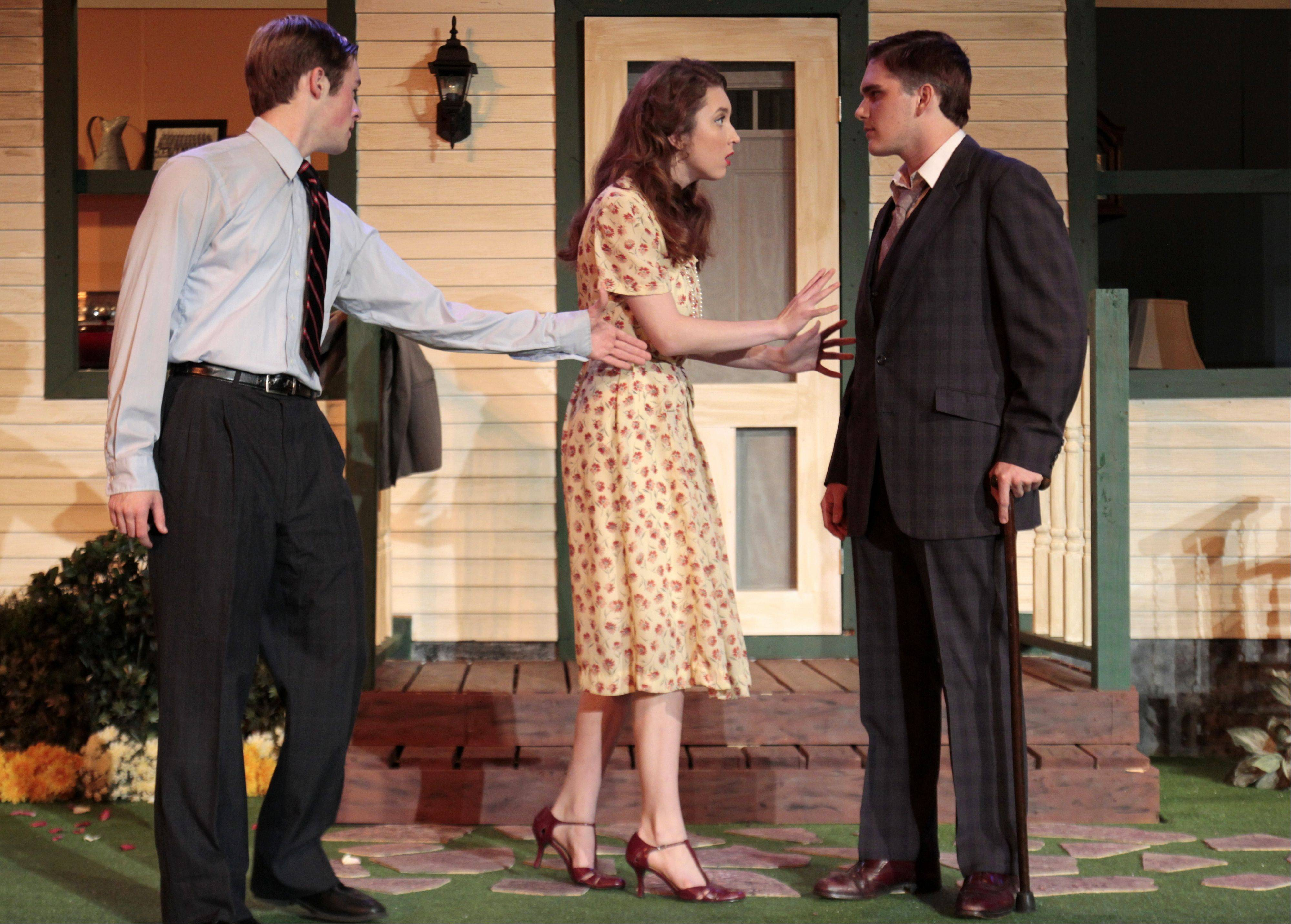 "From left, Brendan Pedersen, Emma Krupp and Conrad Pelletier rehearse their roles as Chris Keller, Ann Deever and George Deever, in the Cary-Grove High School production of ""All My Sons."""