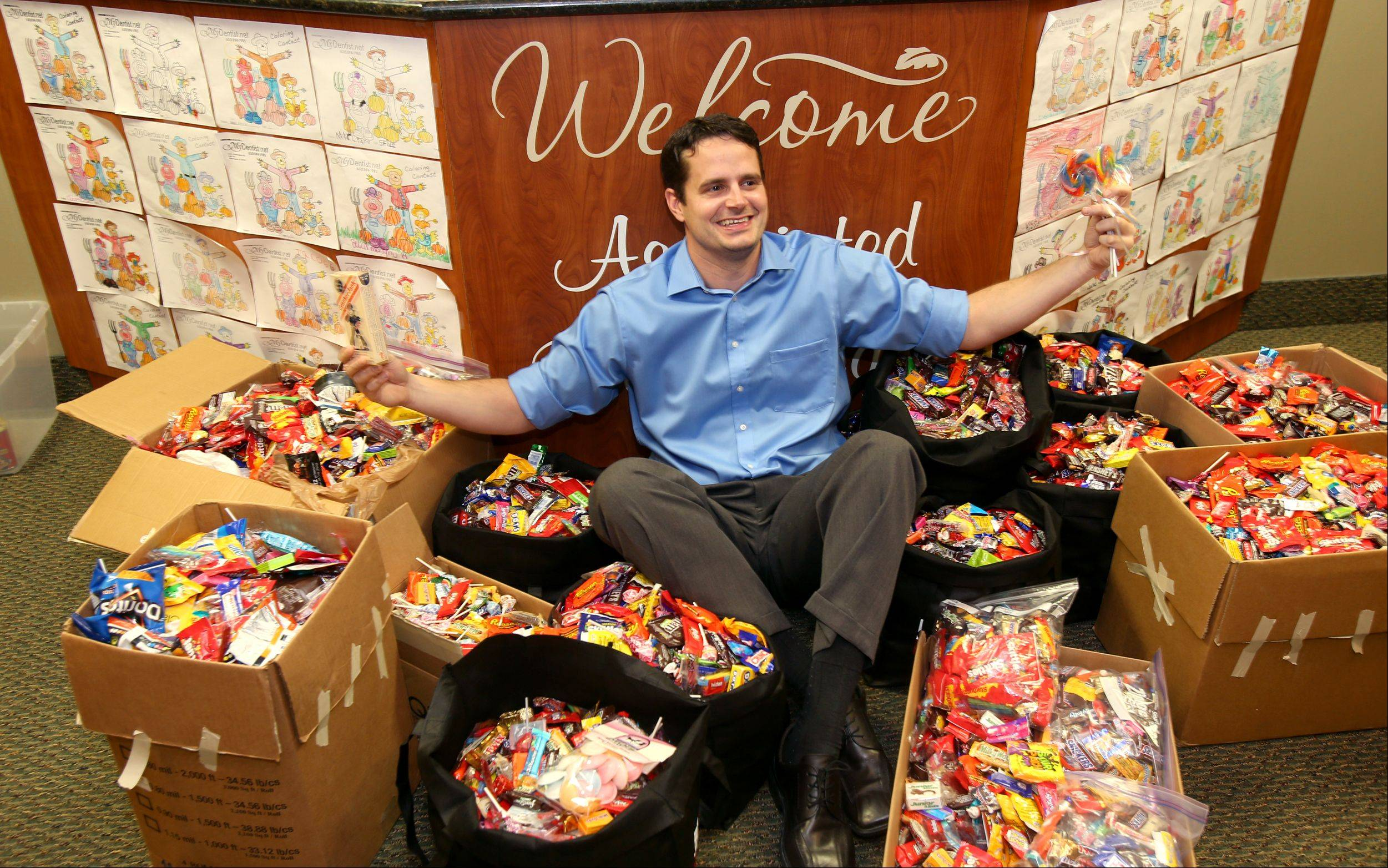 Dr. Adam Szatkowski of Associated Dental Care in Bloomingdale is surrounded by nearly 500 pounds of candy that will be shipped to U.S. troops through Operation Gratitude, a California-based charity.