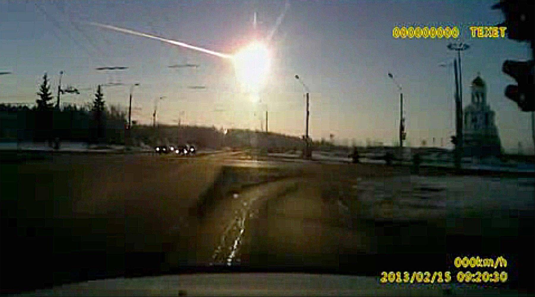 In photo from a dashboard camera video shows a meteor streaking through the sky over Chelyabinsk, about 930 miles east of Moscow, Friday, Feb. 15, 2013.