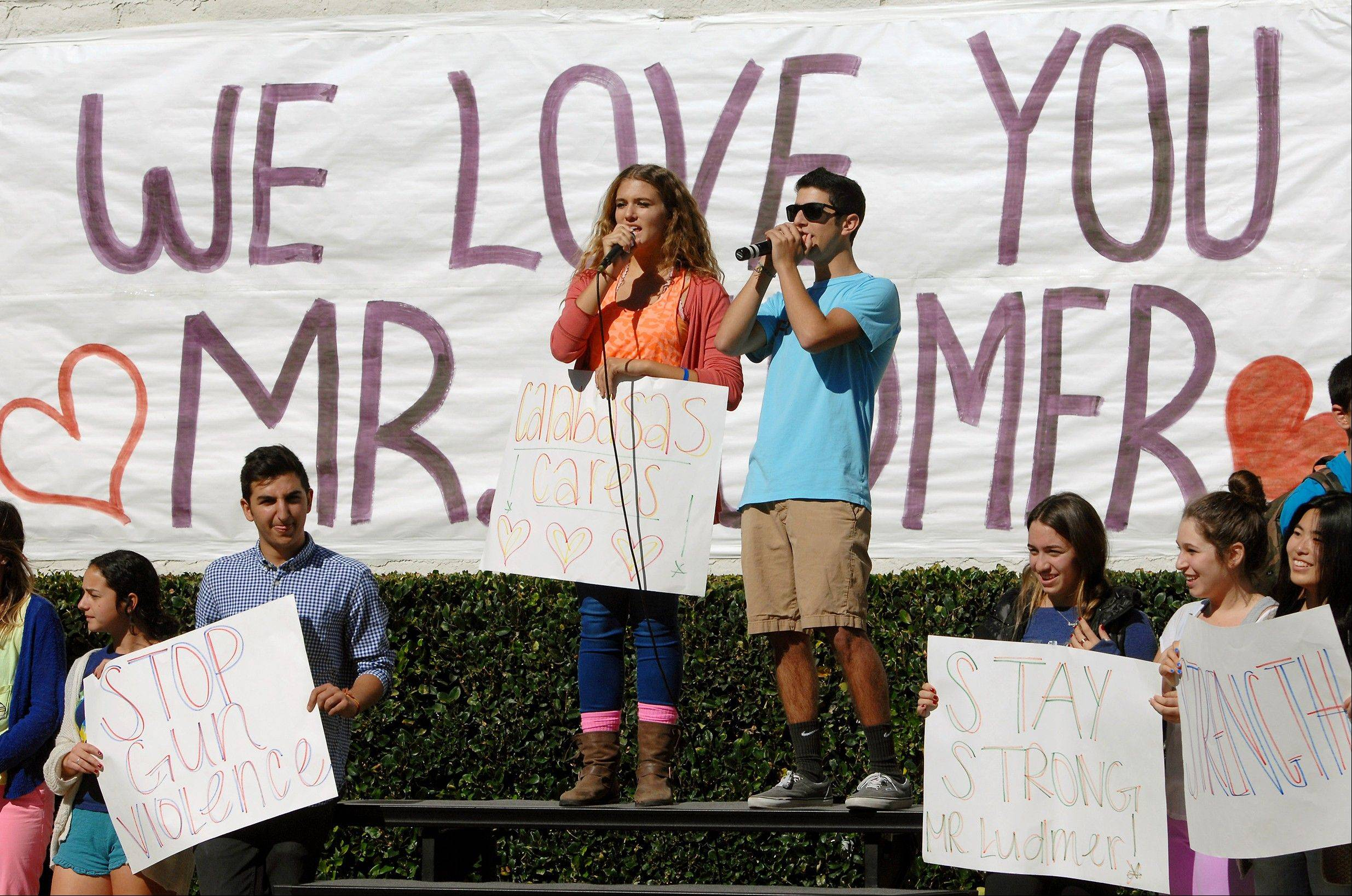 Students hold a rally to support teacher Brian Ludmer at Calabasas High School, Tuesday, Nov. 5, 2013. Ludmer was shot at Los Angeles International Airport, Nov. 1, and remains in the hospital after a bullet hit his calf and shattered a bone. Doctors say he'll recover.
