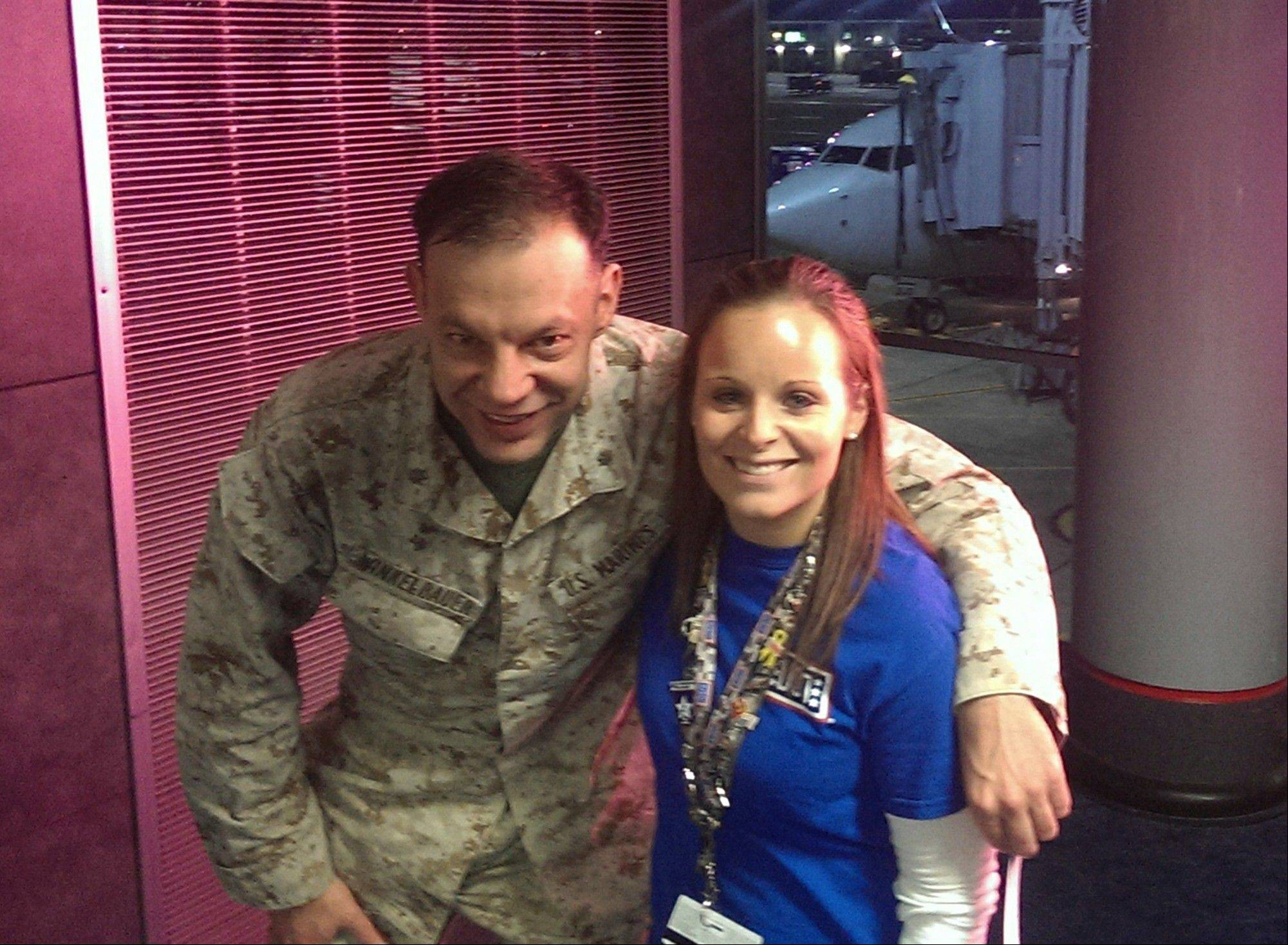 Lindsy Wadas, director of the USO Center at O'Hare International Airport with U.S. Marine Maj. Matthew Winkelbauer, left, after he and 12 other Marines arrived in Chicago before the final leg of their trip home to San Diego.