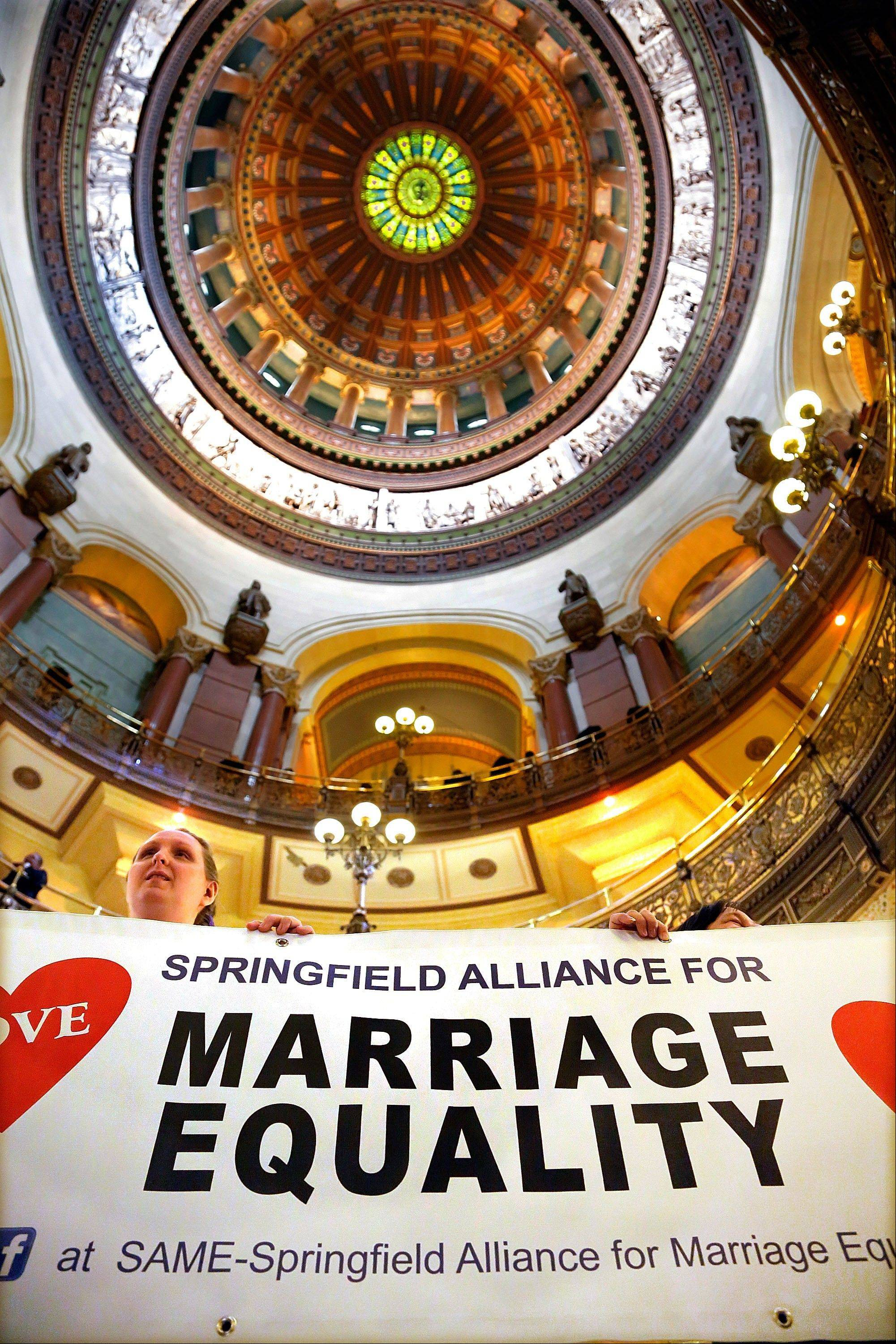 Supporters of same-sex marriage legislation rally in the rotunda at the Illinois State Capitol during the veto session Tuesday in Springfield.