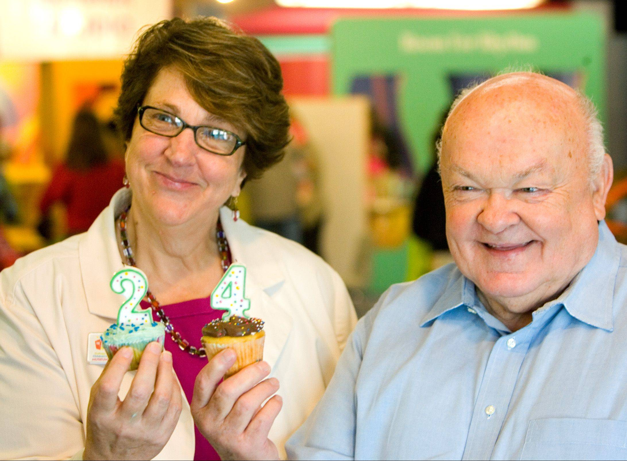 Susan Broad, left, the longtime president and CEO of the DuPage Children's Museum, celebrates one of the facility's anniversaries with Mayor George Pradel. Broad is stepping down at the end of January after more than 22 years at the helm of the museum that attracts more than 300,000 visitors a year.