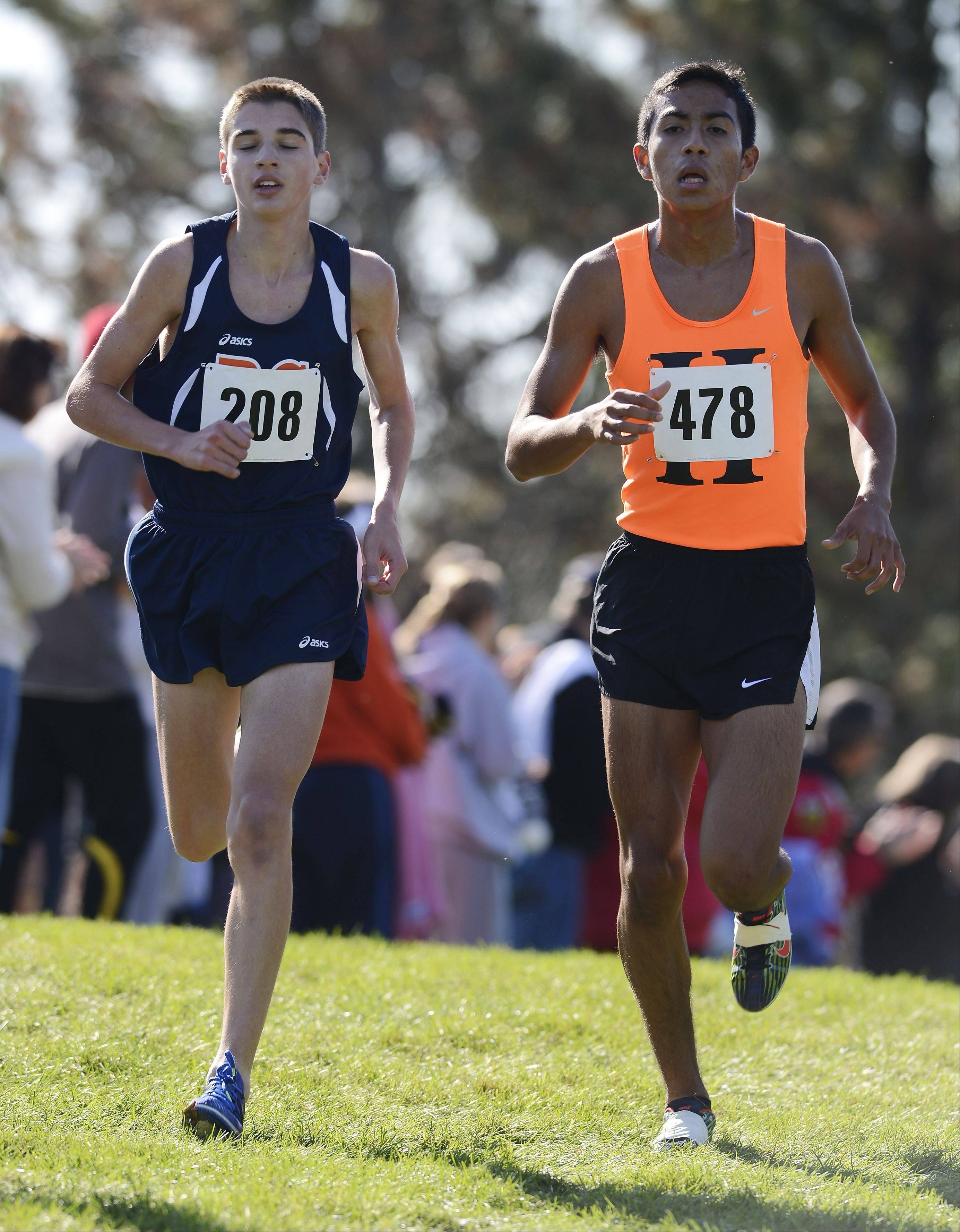 Buffalo Grove senior Kevin Salvano, left, and Hersey junior David Rodriguez run alongside one another during the Mid-Suburban League cross country meet at Willow Stream Park.