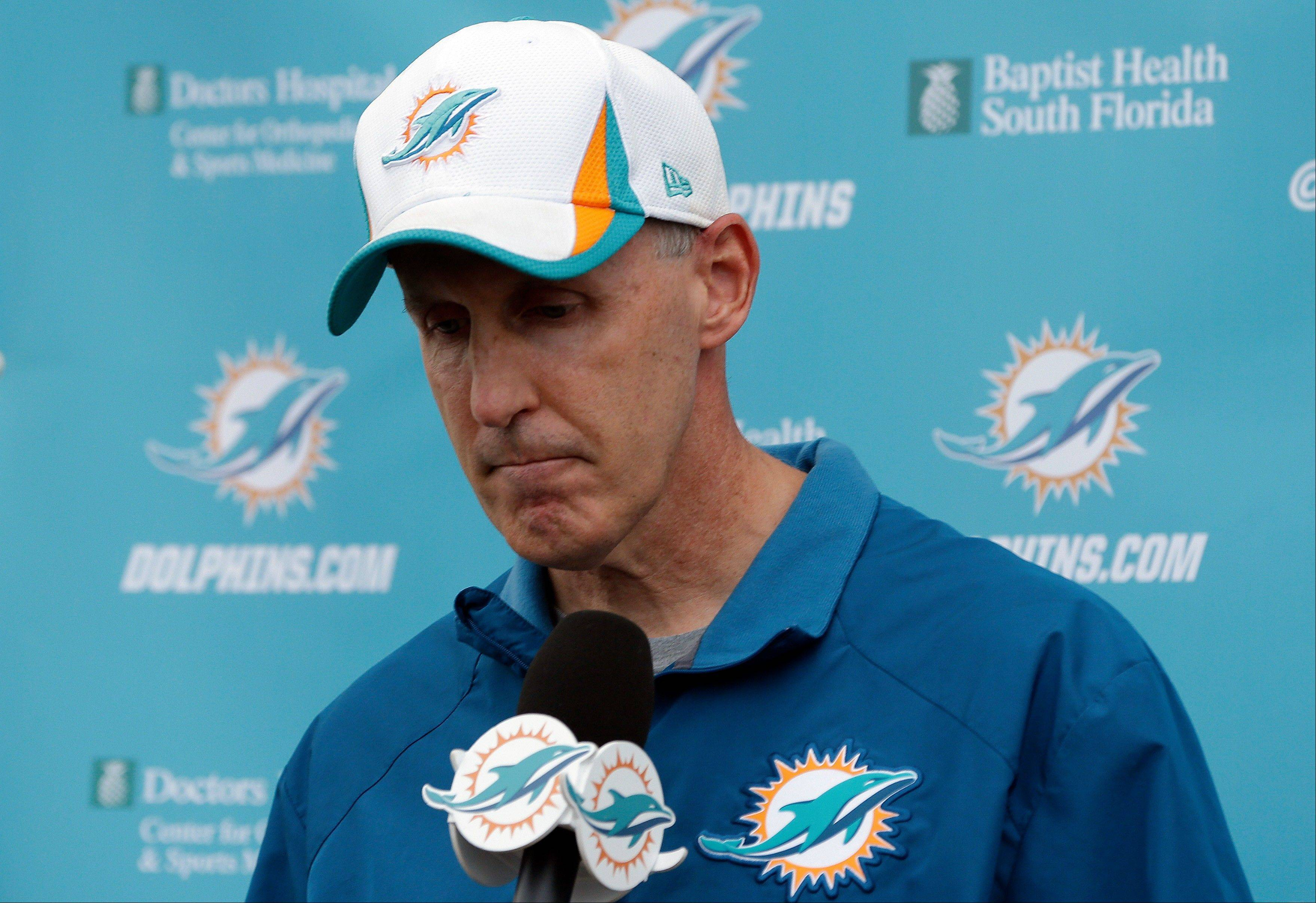 Miami Dolphins head coach Joe Philbin looks down during a media availability following an NFL football practice, Monday, Nov. 4, 2013, in Davie, Fla. The Dolphins suspended guard Richie Incognito Sunday for misconduct related to the treatment of teammate Jonathan Martin, who abruptly left the team a week ago to receive help for emotional issues.