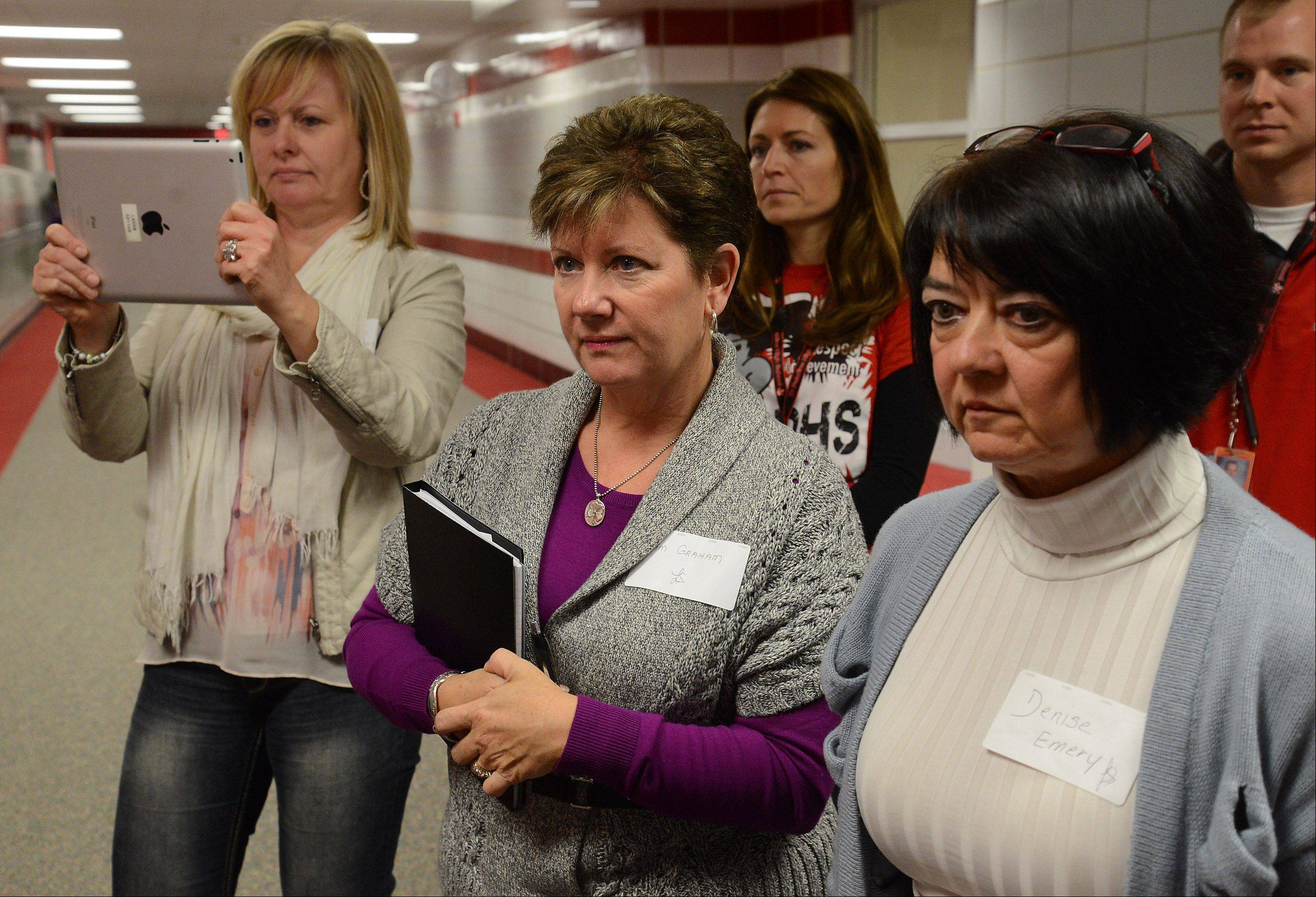 Visiting educators from Canada from left, Shelley Martsch-Litt, Pam Graham and Denise Emery are given a tour by Palatine High School principal Gary Steiger to learn about the school's Commit to the Pirate program.