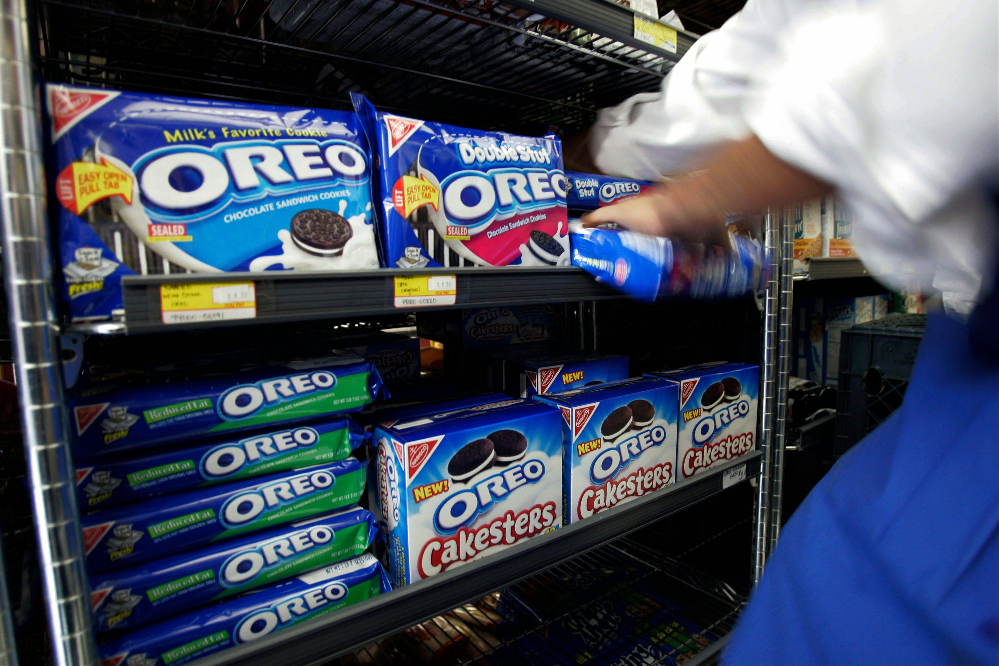 A worker fixes the display of Oreo cookies at a market in Palo Alto, Calif.