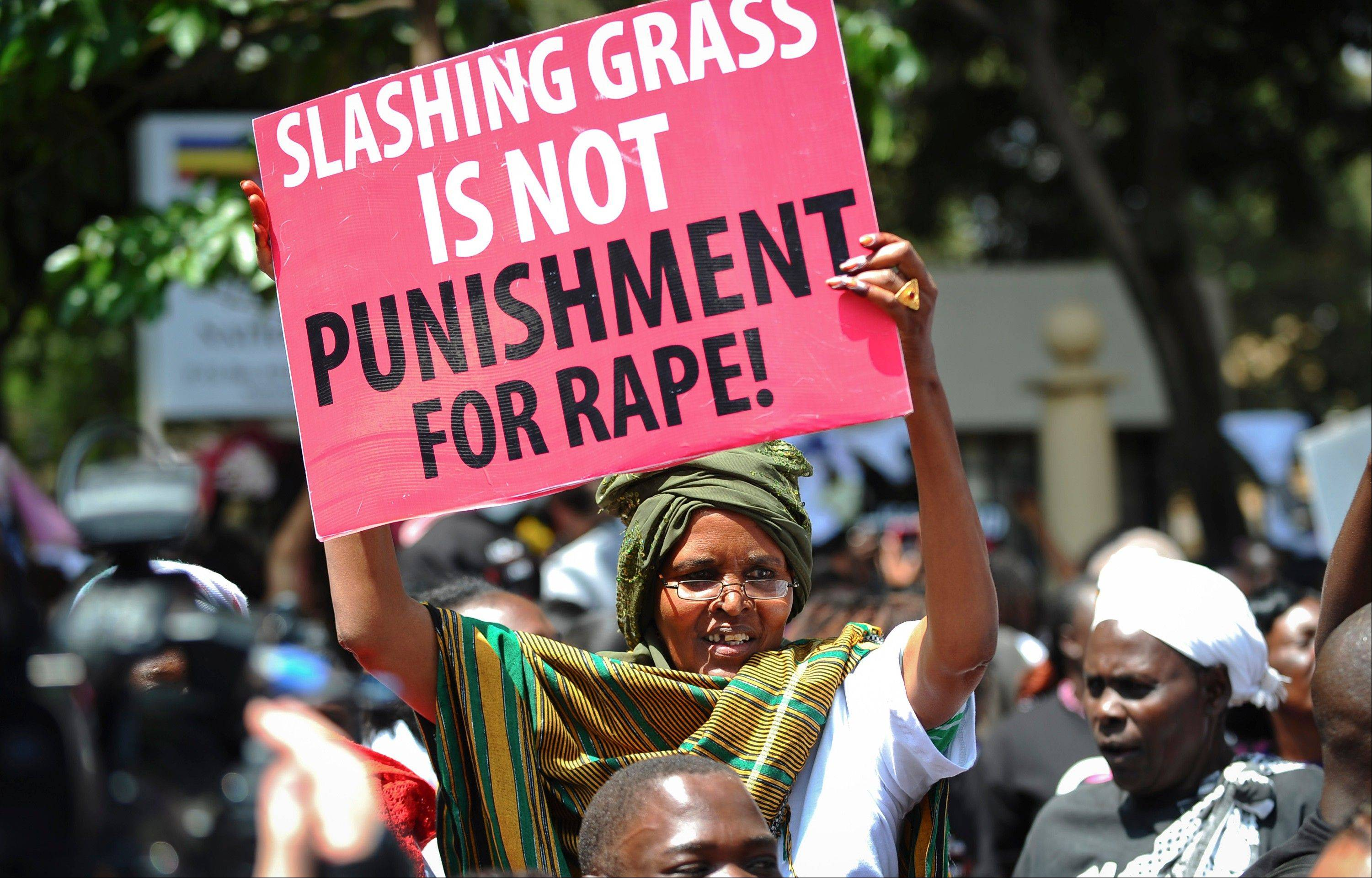 In this photo from Oct. 31, Kenyan women protest after a teenager was allegedly gang-raped in Nairobi and the alleged attackers were let go after police made them cut the grass around the station.