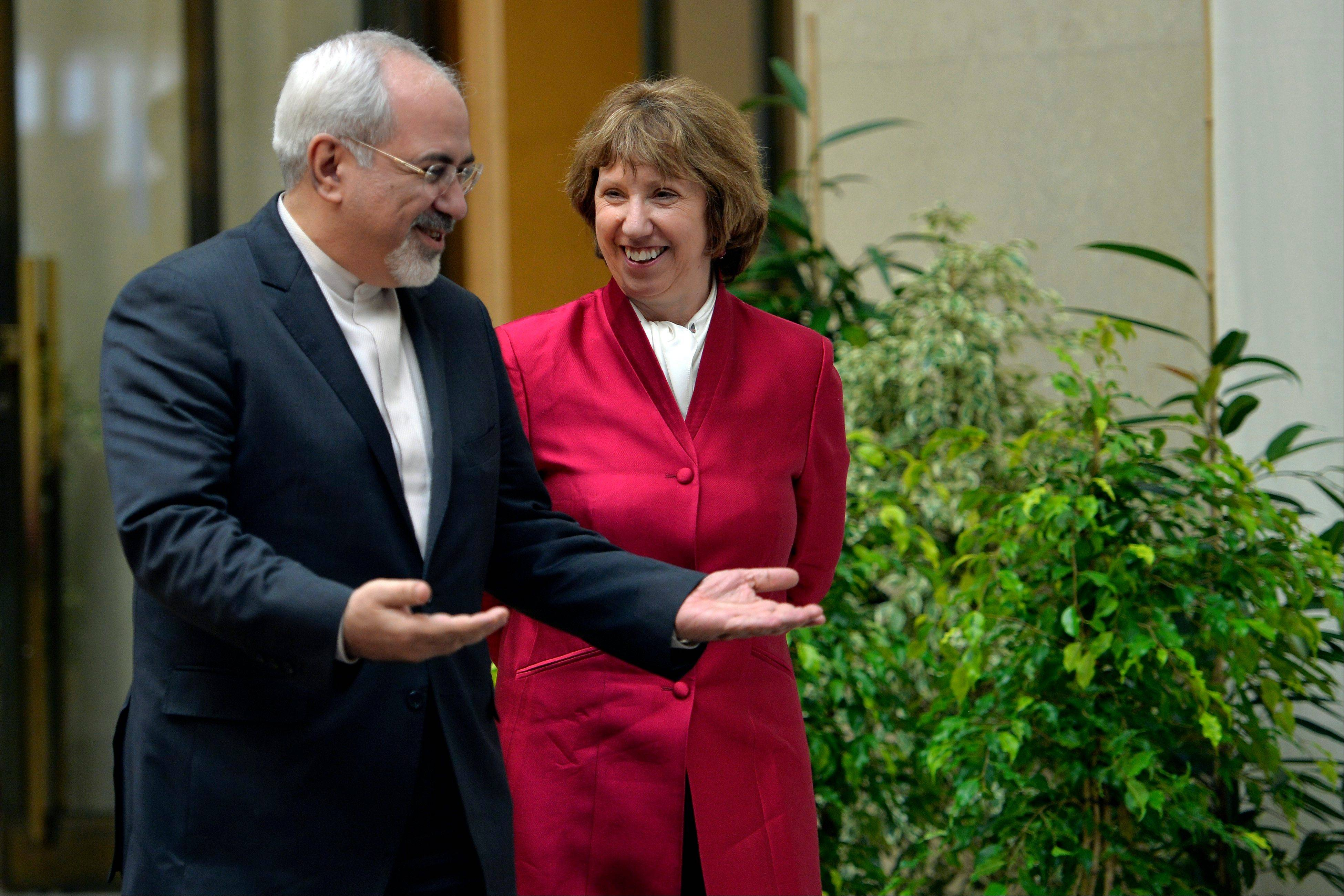 EU High Representative for Foreign Affairs Catherine Ashton, right, walks next to Iranian Foreign Minister Mohammed Javad Zarif, left, before the start of two days of closed-door nuclear talks at the United Nations offices in Geneva Switzerland.