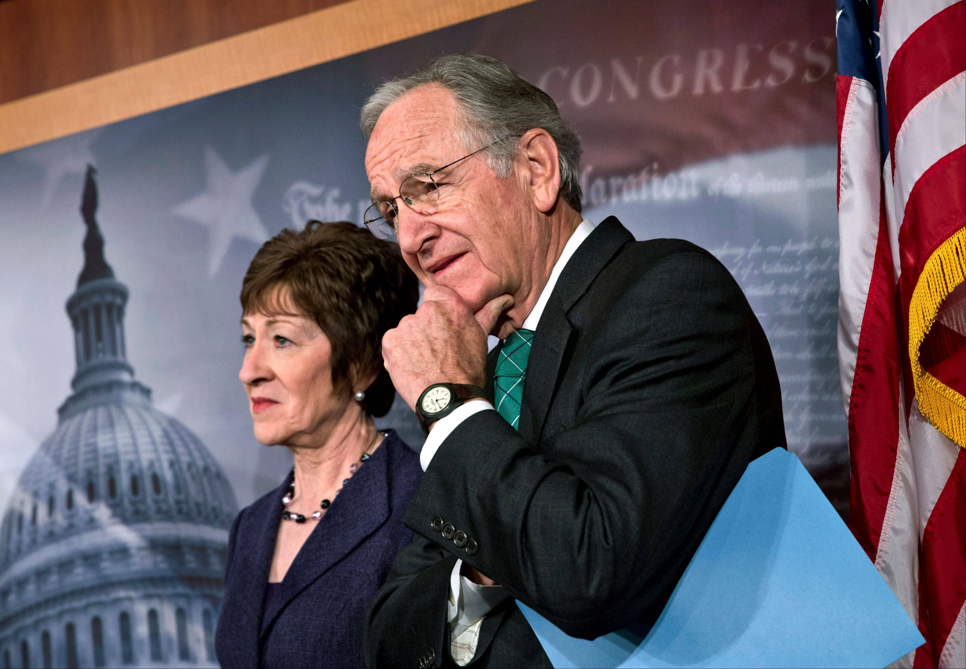 Sen. Tom Harkin, right, chairman of the Health, Education, Labor, and Pensions Committee, stands with Sen. Susan Collins earlier this week, just after the Senate cleared a major hurdle and agreed to proceed to debate a bill that would prohibit workplace discrimination against gay, bisexual and transgender Americans.